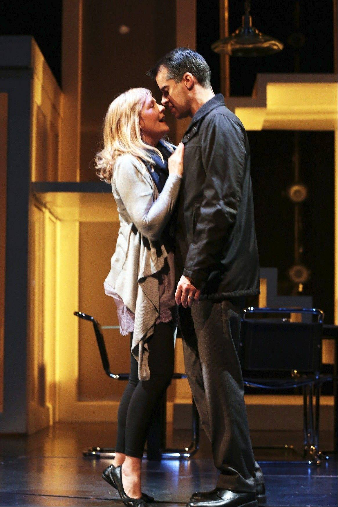 "Diana Goodman (Susie McMonagle) confronts her husband, Dan (Rod Thomas), in the Pulitzer Prize-winning musical ""Next to Normal"" at Drury Lane Theatre in Oakbrook Terrace."