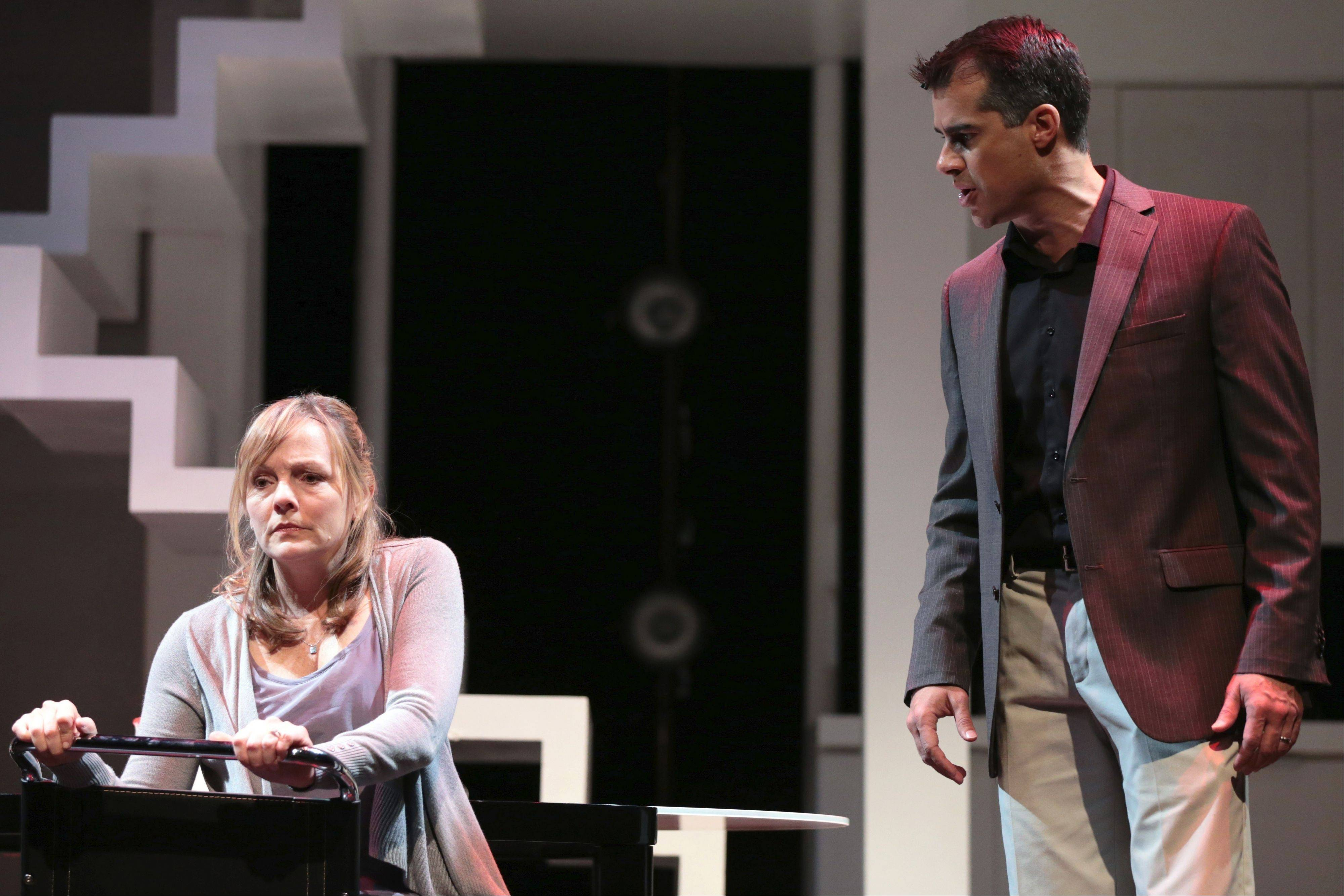 "Diana Goodman (Susie McMonagle) argues with her husband, Dan (Rod Thomas), in the Pulitzer Prize-winning musical ""Next to Normal"" at Drury Lane Theatre in Oakbrook Terrace."