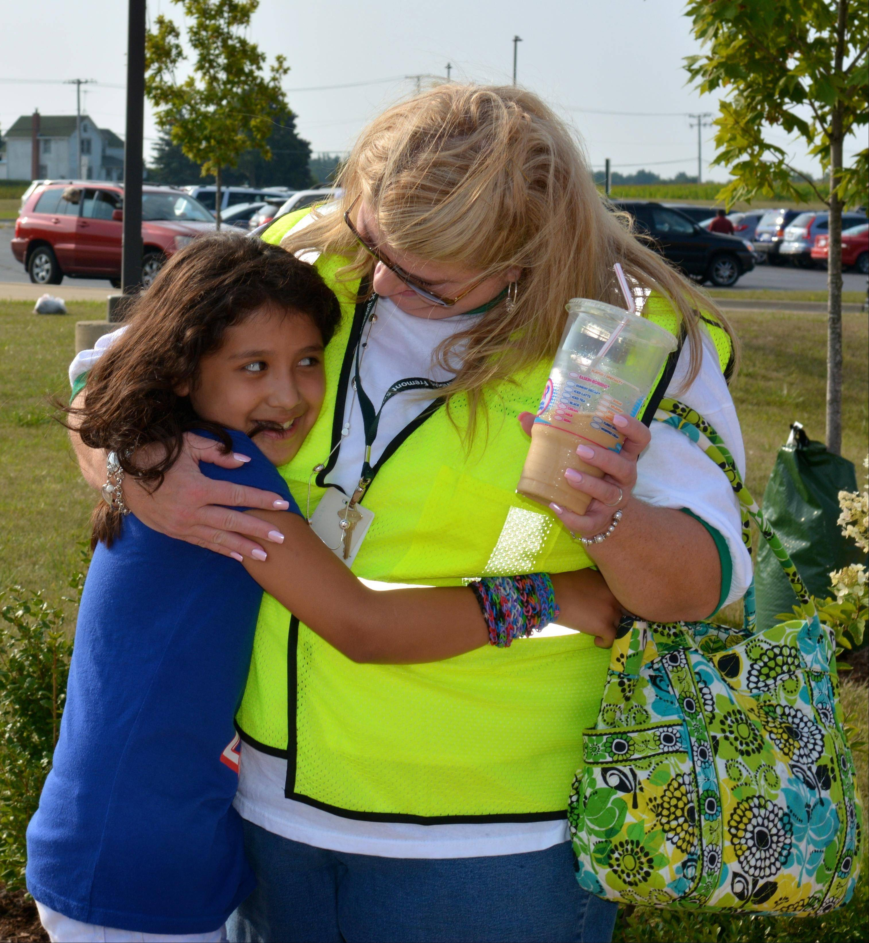 Mireya Elizabeth Cardenas of Round Lake hugs Fremont employee Colleen Downey on the first day of school earlier this month in Mundelein. Mireya drowned Tuesday night in Fox Lake.