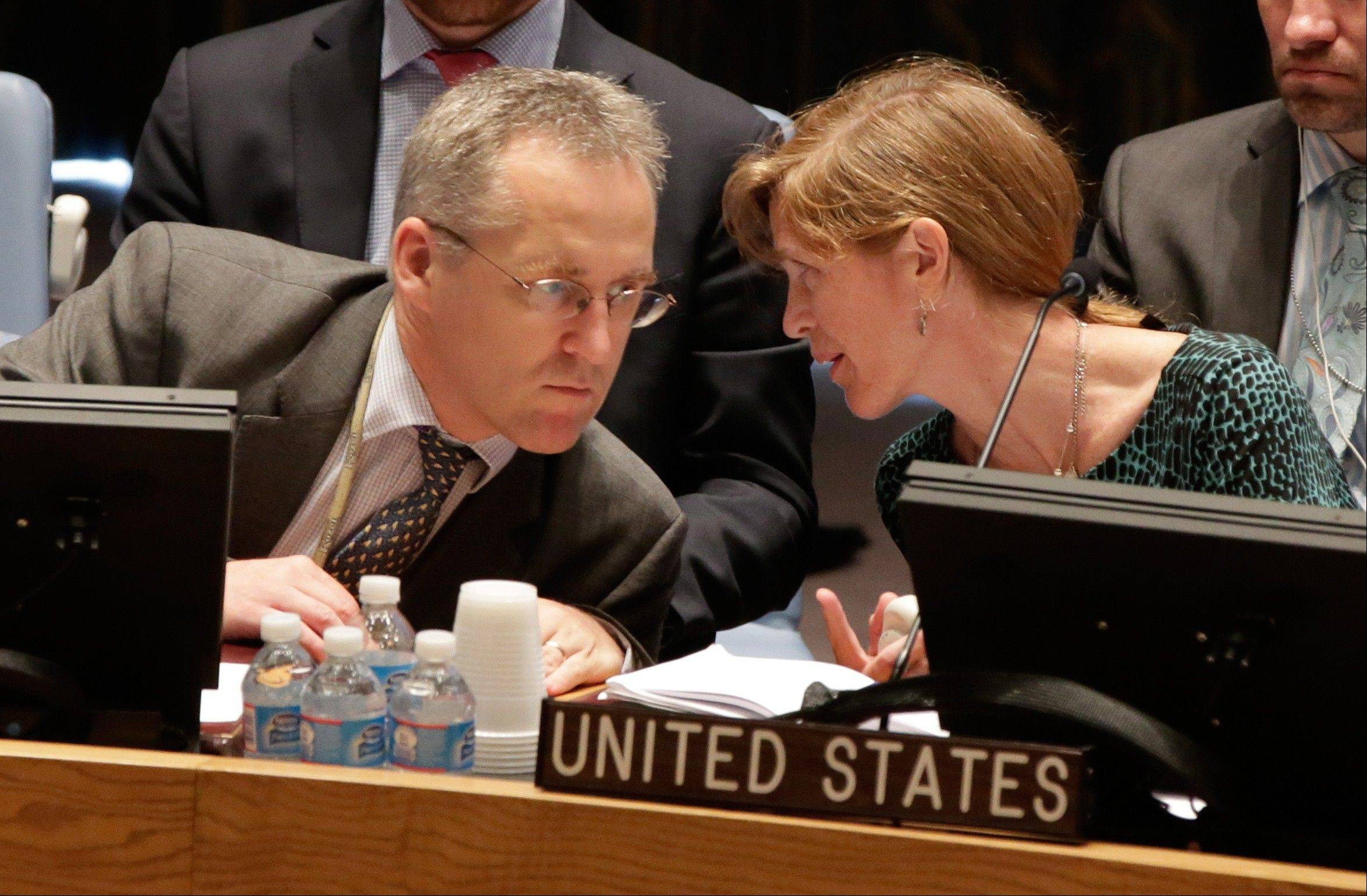 U.S. Ambassador Samantha Power talks with British delegate, Michael Tatham, in the United Nations Security Council Thursday. U.N. Secretary-General Ban Ki-moon said the inspection team in Syria is expected to complete its work Friday and report to him Saturday.