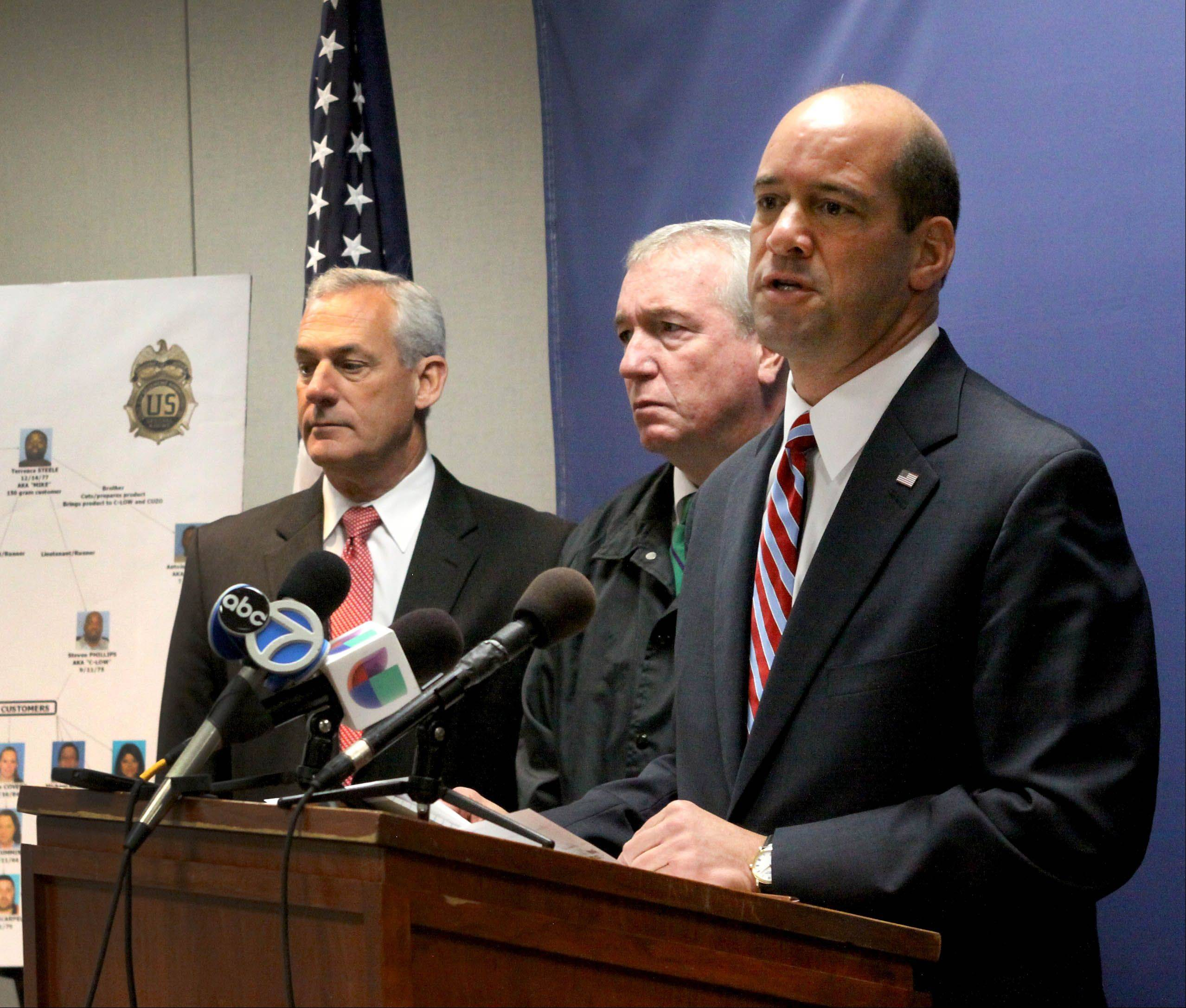 Left to right are Mark Piccoli, DuPage Metro Enforcement Group, DEA Special Agent Jack Riley and DuPage County State's Attorney Robert Berlin announcing that 31 people have been arrested in a heroin conspiracy bust in Cook and DuPage counties, during a news conference yesterday at the DuPage County Courthouse in Wheaton.