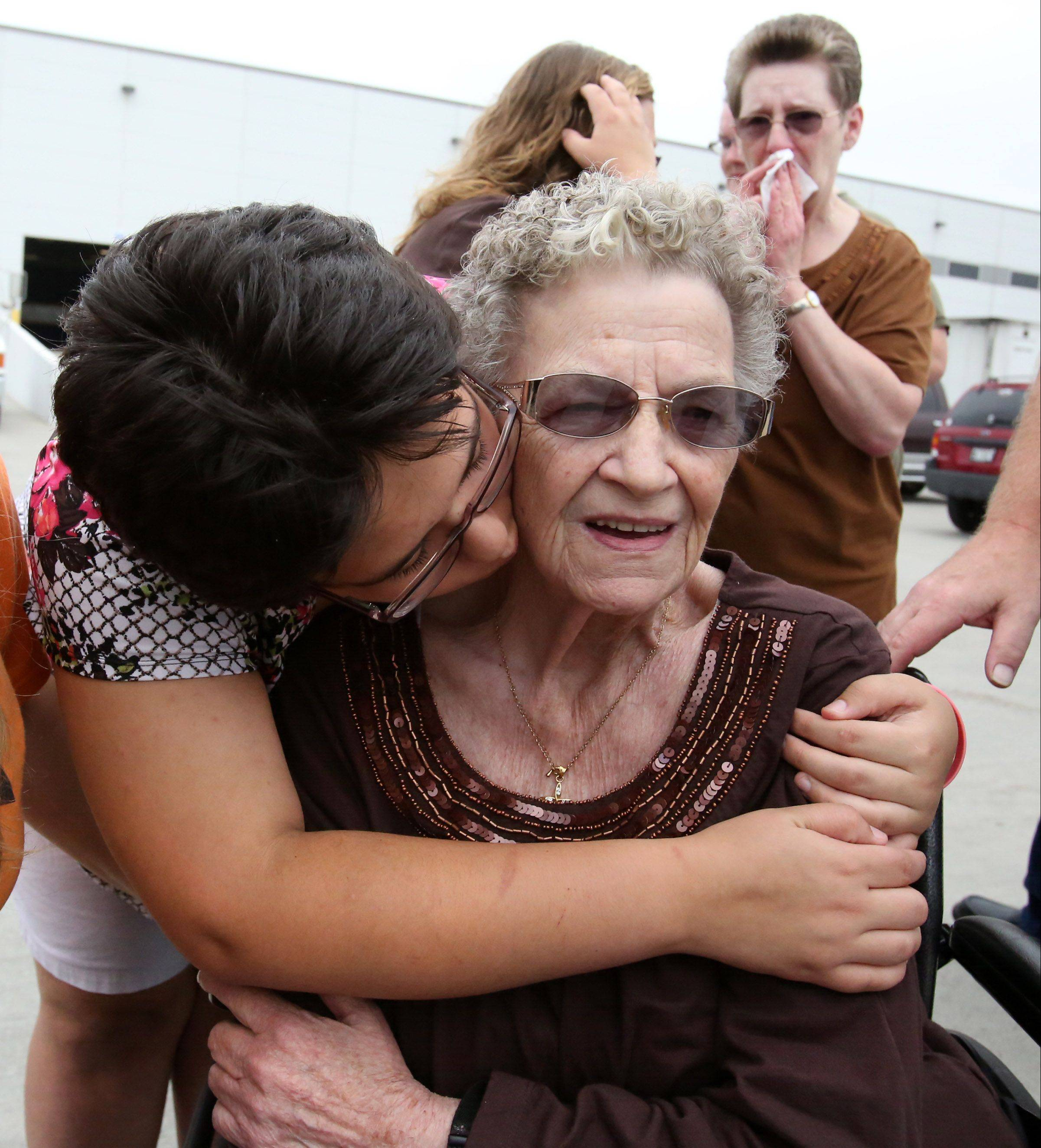 Donna Mitchell, 80, is consoled Wednesday by Destiny Fenscke, both of McHenry, as the remains of Mitchell's twin brother, Army Cpl. Donald V. MacLean, are returned home. Mitchell's daughter, Donna Keefer of McHenry, wipes a tear in the background.
