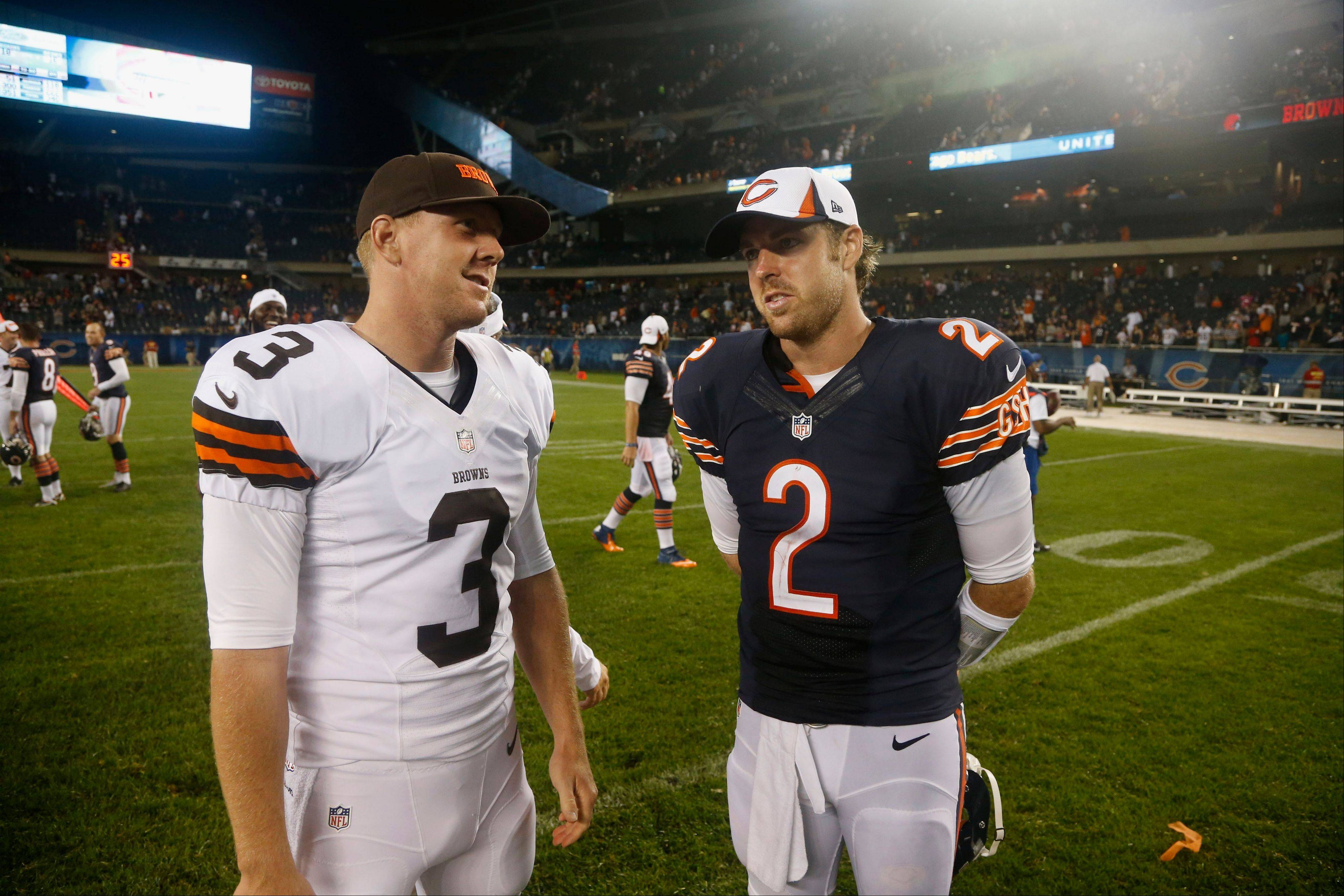 Cleveland Browns quarterback Brandon Weeden (3) and Chicago Bears quarterback Jordan Palmer (2) talk after the Browns' 18-16 win over the Bears in a preseason NFL football game on Thursday, Aug. 29, 2013, in Chicago.
