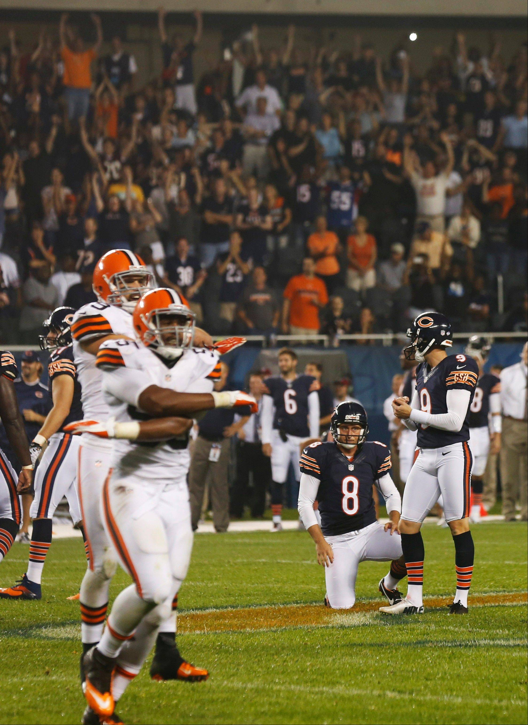 Cleveland Browns players react as Bears kicker Robbie Gould, right, misses a 57-yard field goal-attempt during the second half of a preseason NFL game on Thursday in Chicago. The Browns won 18-16.