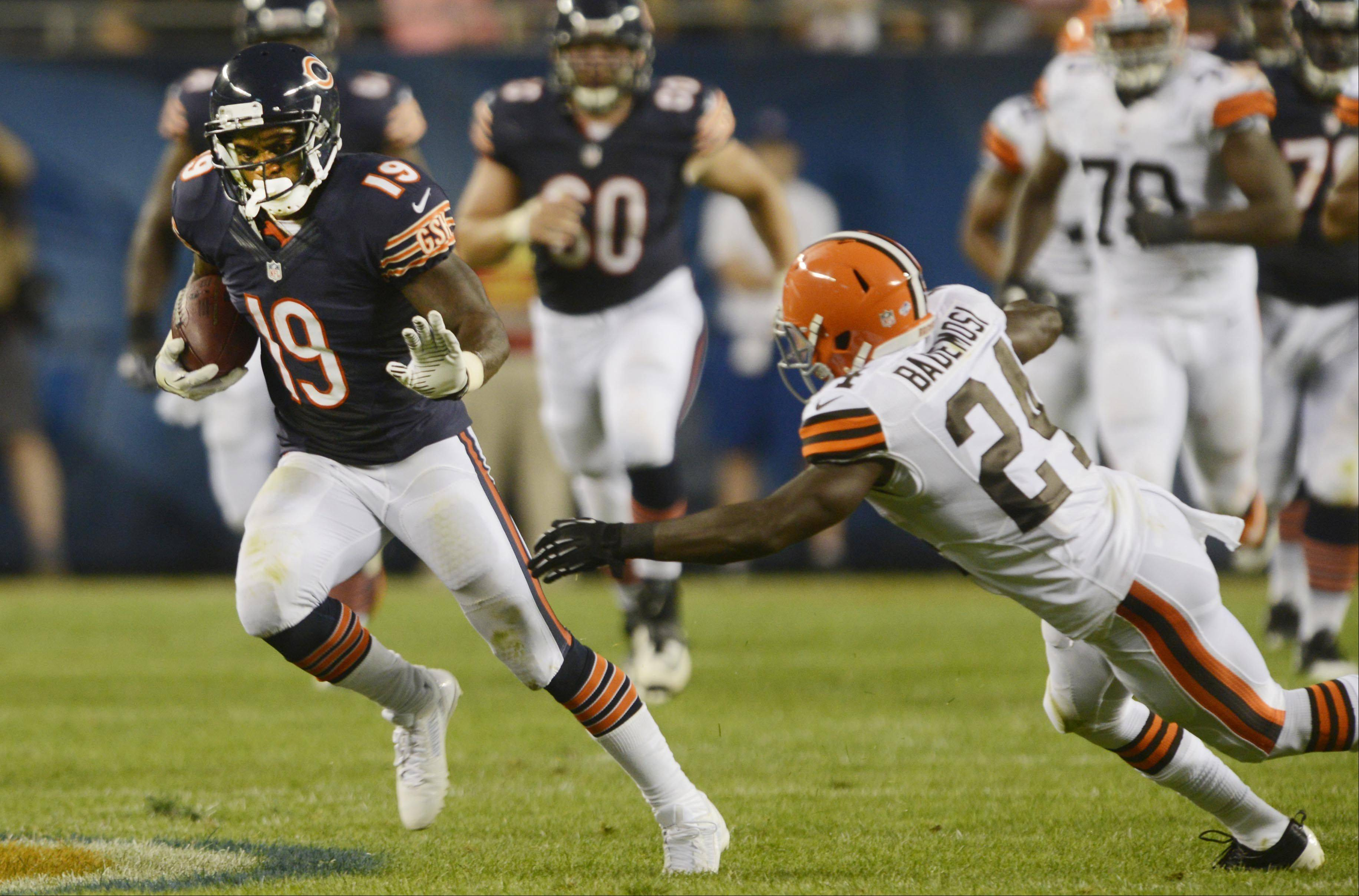 Chicago Bears wide receiver Joe Anderson runs with a pass against the defense of Cleveland Browns cornerback Johnson Bademosi.