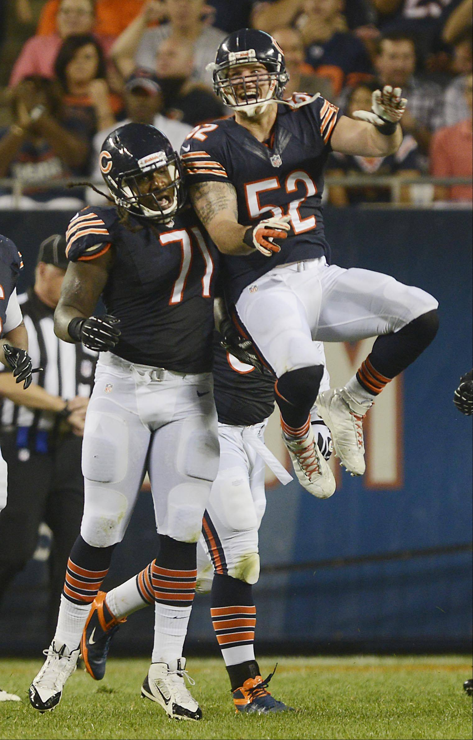 Chicago Bears outside linebacker Blake Costanzo celebrates teammate defensive end Aston Whiteside's sack .