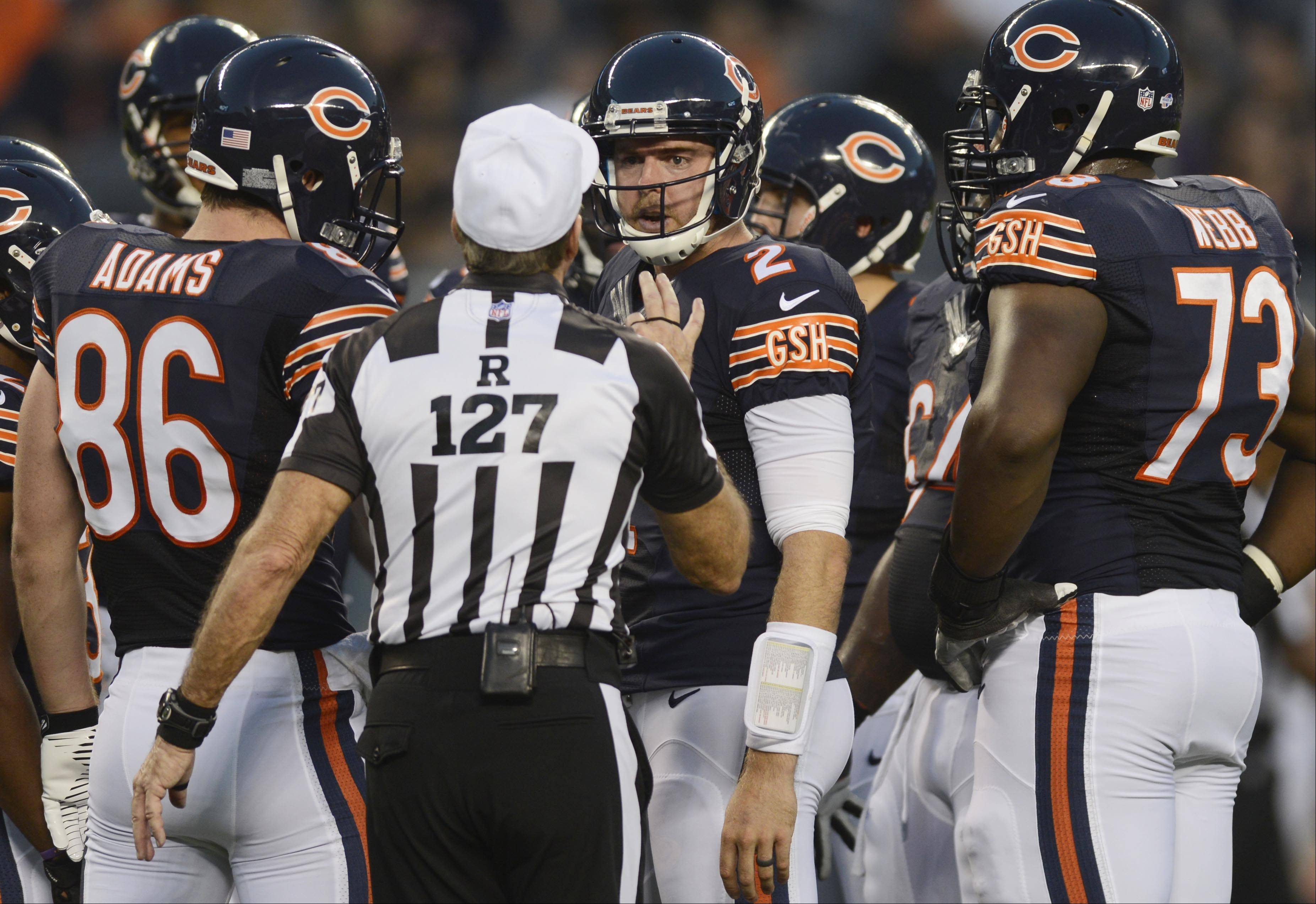 Chicago Bears quarterback Jordan Palmer listens to a referee.