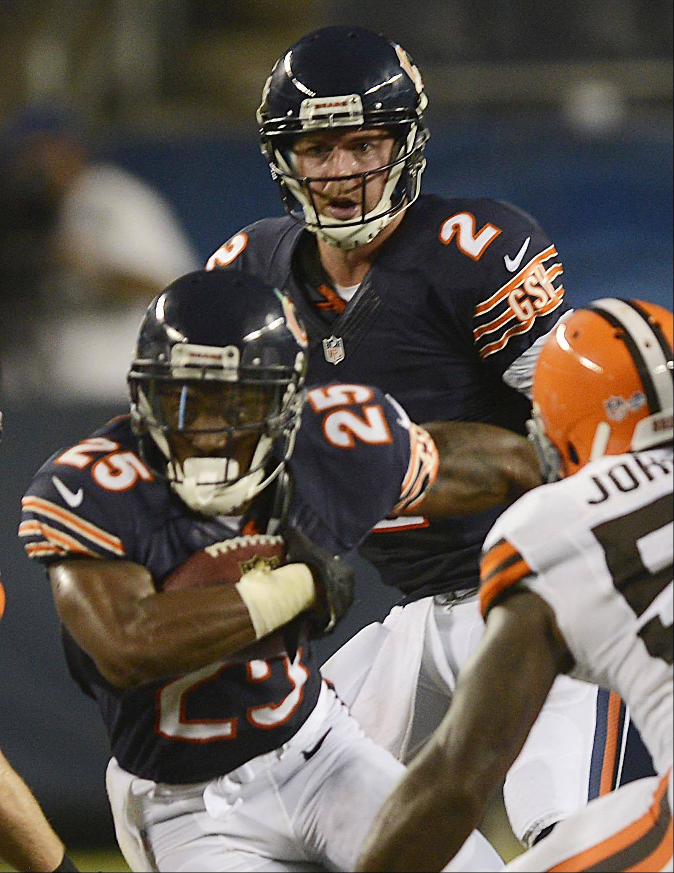 Chicago Bears quarterback Jordan Palmer watches running back Armando Allen take the ball against the Clevelend Browns.
