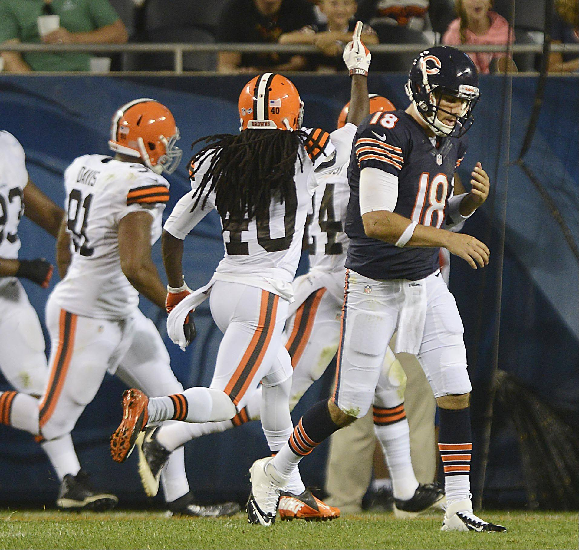 Chicago Bears quarterback Trent Edwards leaves the field after throwing an interception.