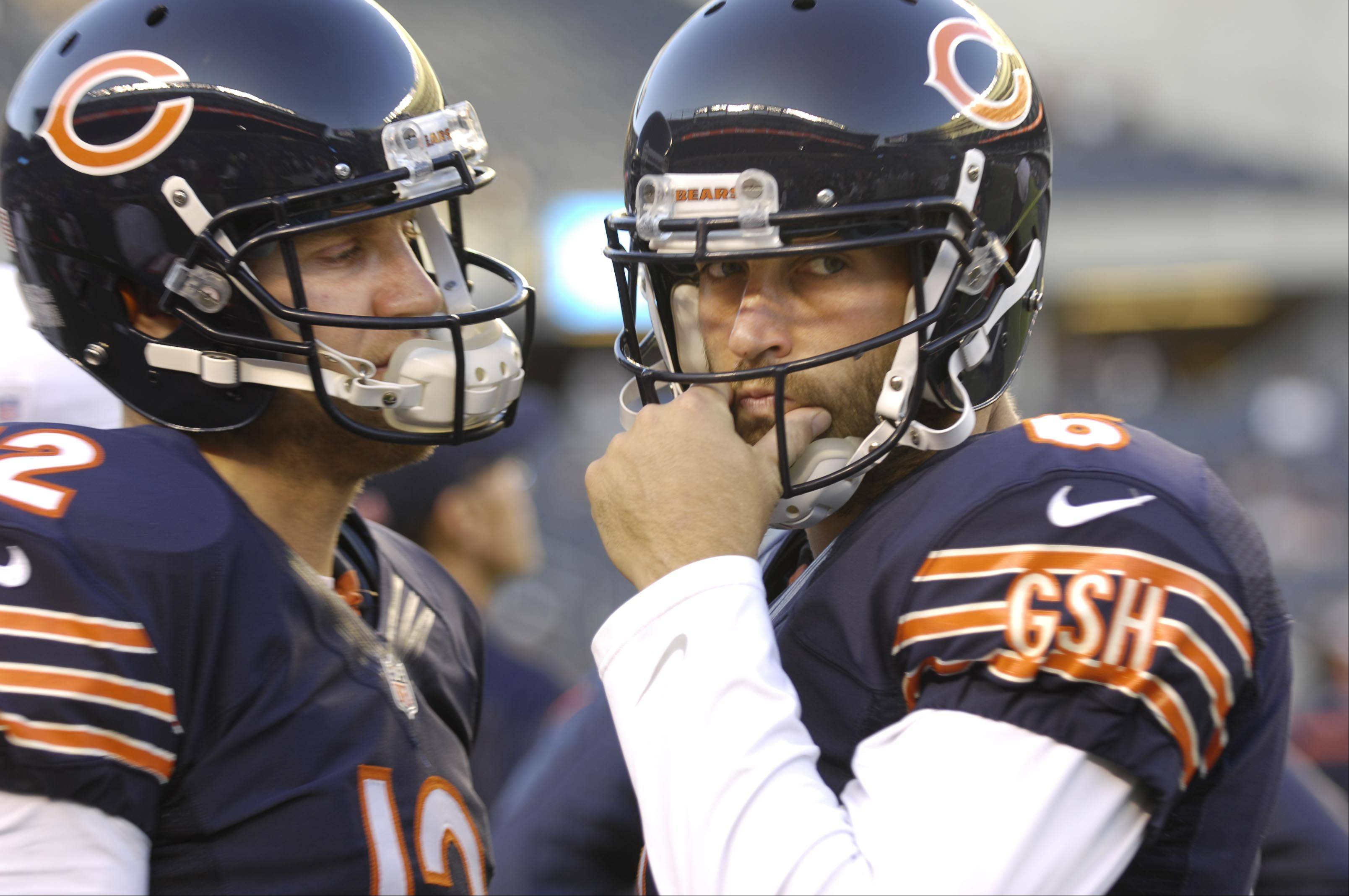 Chicago Bears quarterback Jay Cutler and quarterback Josh McCown talk on the sidelines.