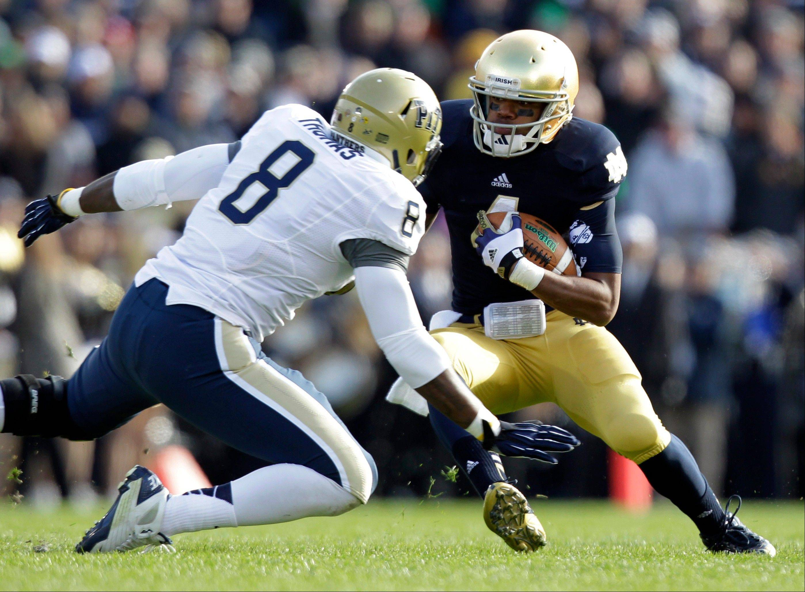 Notre Dame running back George Atkinson III, right, makes a move to get past Pittsburgh linebacker Todd Thomas during a game last season in South Bend, Ind.