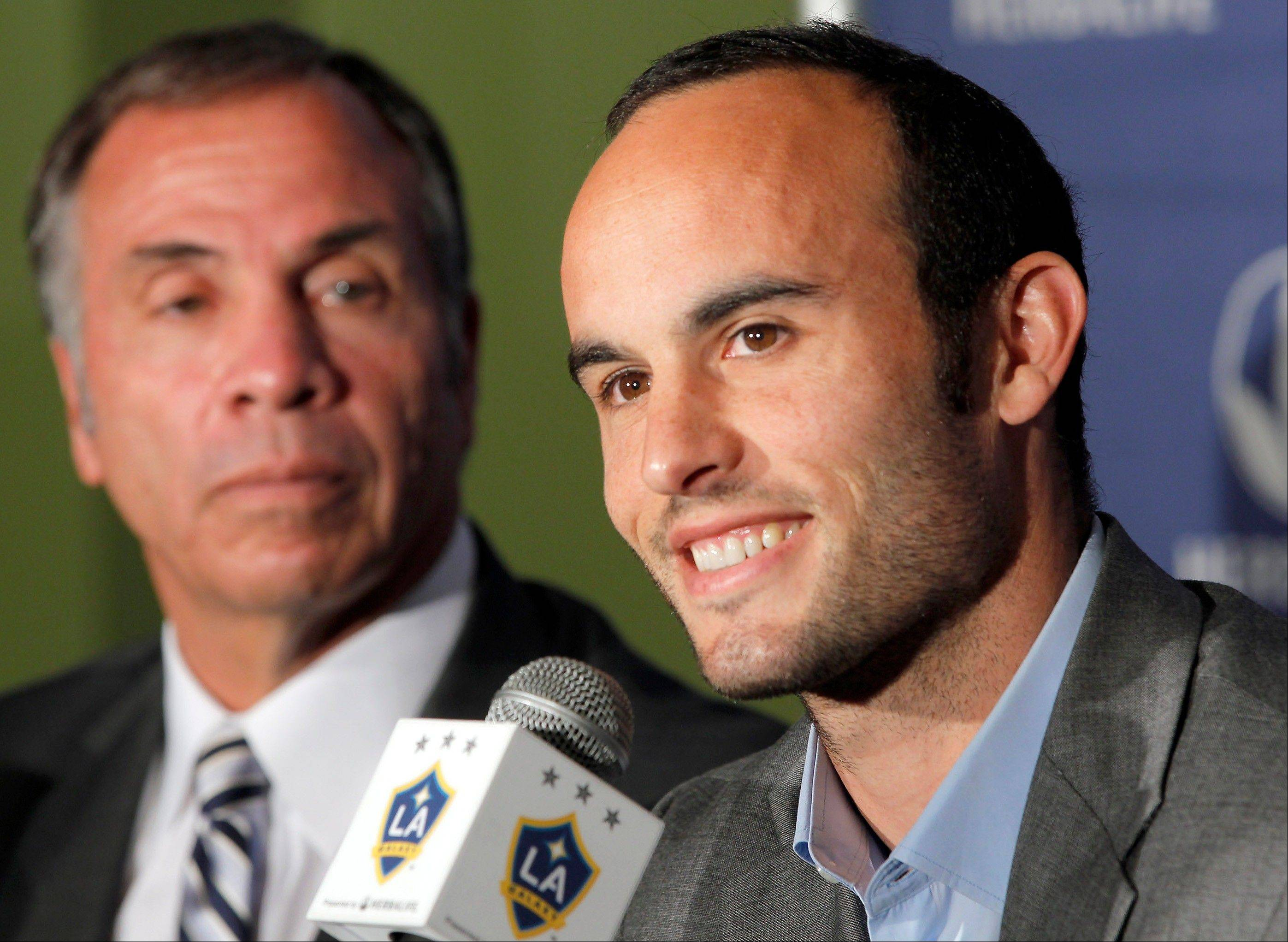 Los Angeles Galaxy forward Landon Donovan, right, signed a multiyear contract extension with on Wednesday, keeping the high-scoring U.S. national team star with his MLS club. He's also back on the U.S. national team.