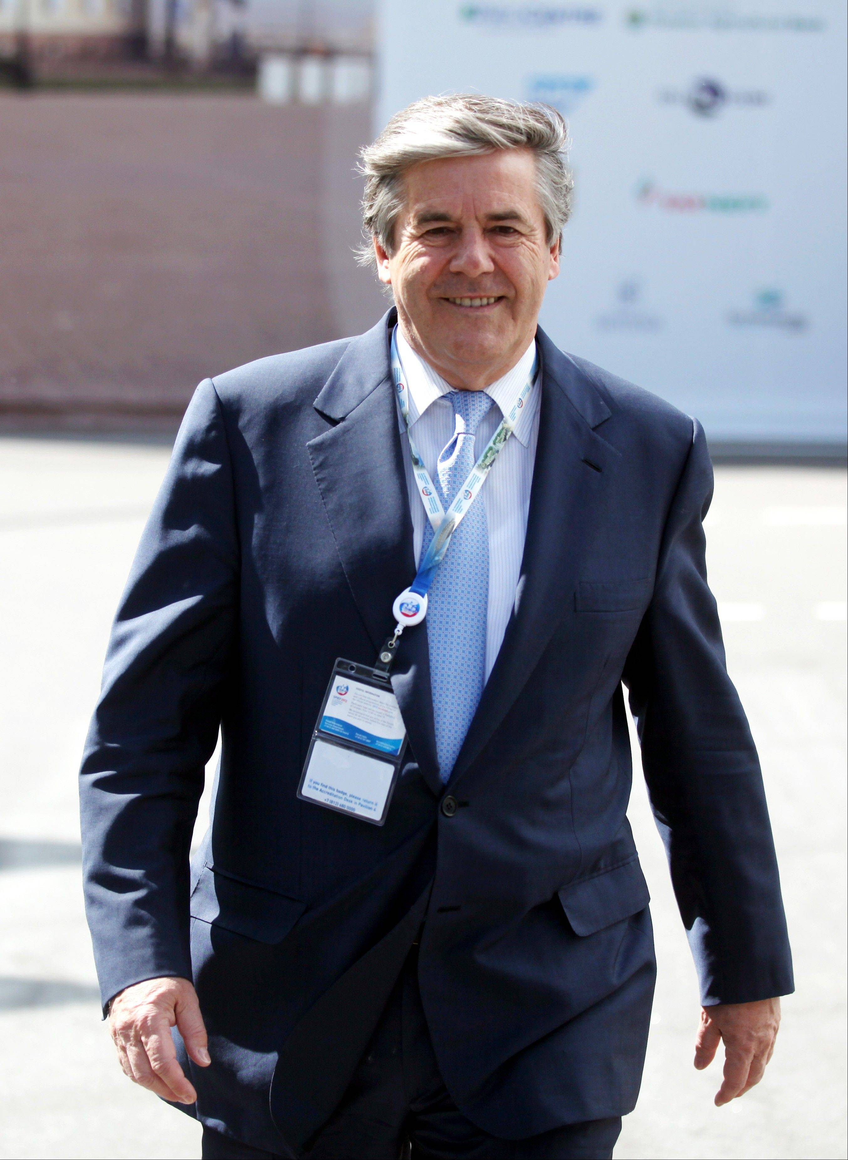 Josef Ackermann, the former chief executive officer of Deutsche Bank AG, walks between conference sessions on day three of the Saint Petersburg International Economic Forum 2012.