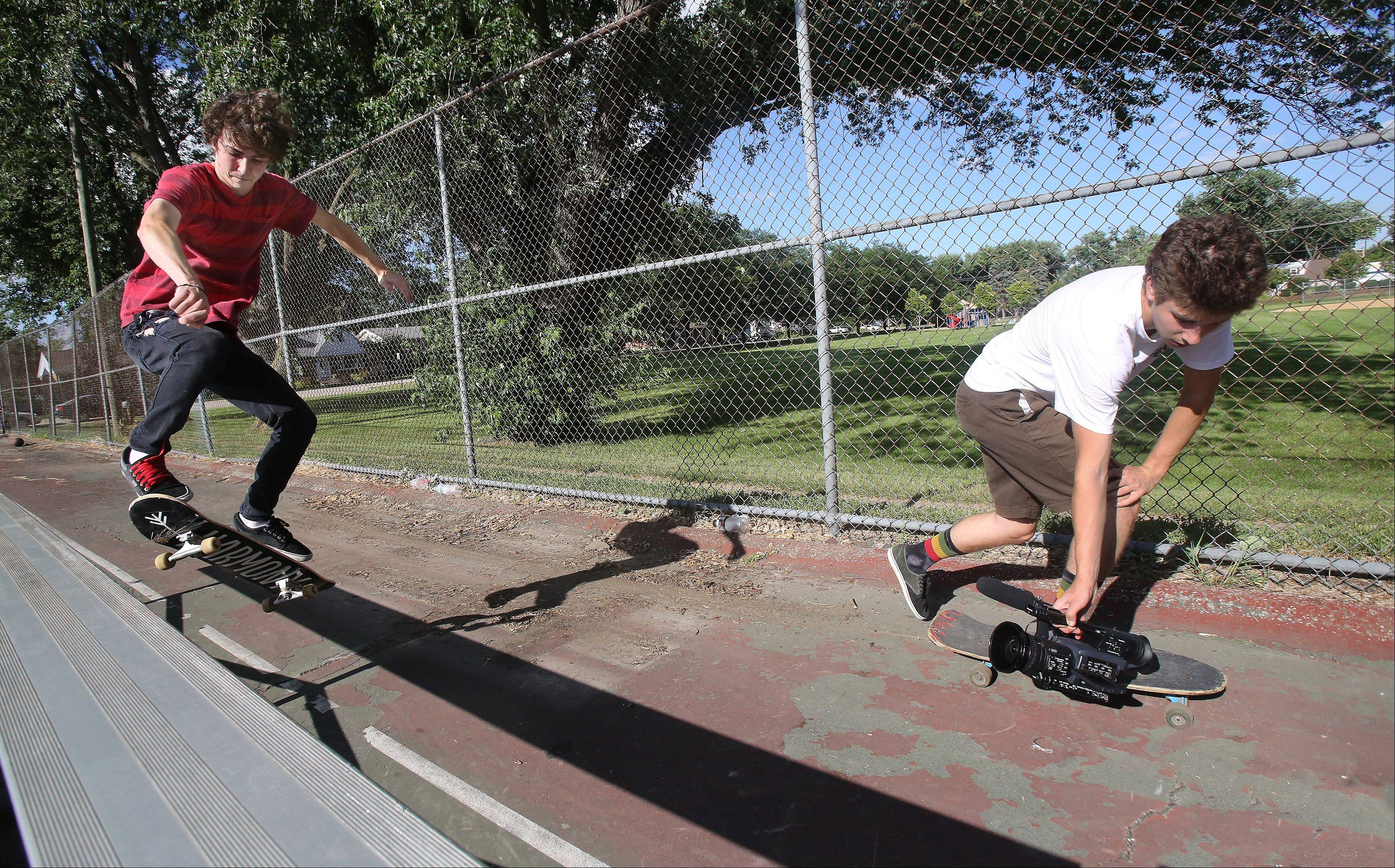 Videographer Max Kollman of Libertyville shoots video of street skateboarder Matt Satchell of Libertyville at an outdoor basketball court in McHenry. Kollman, 18, documents the gritty aspects of the sport using high-end video equipment.