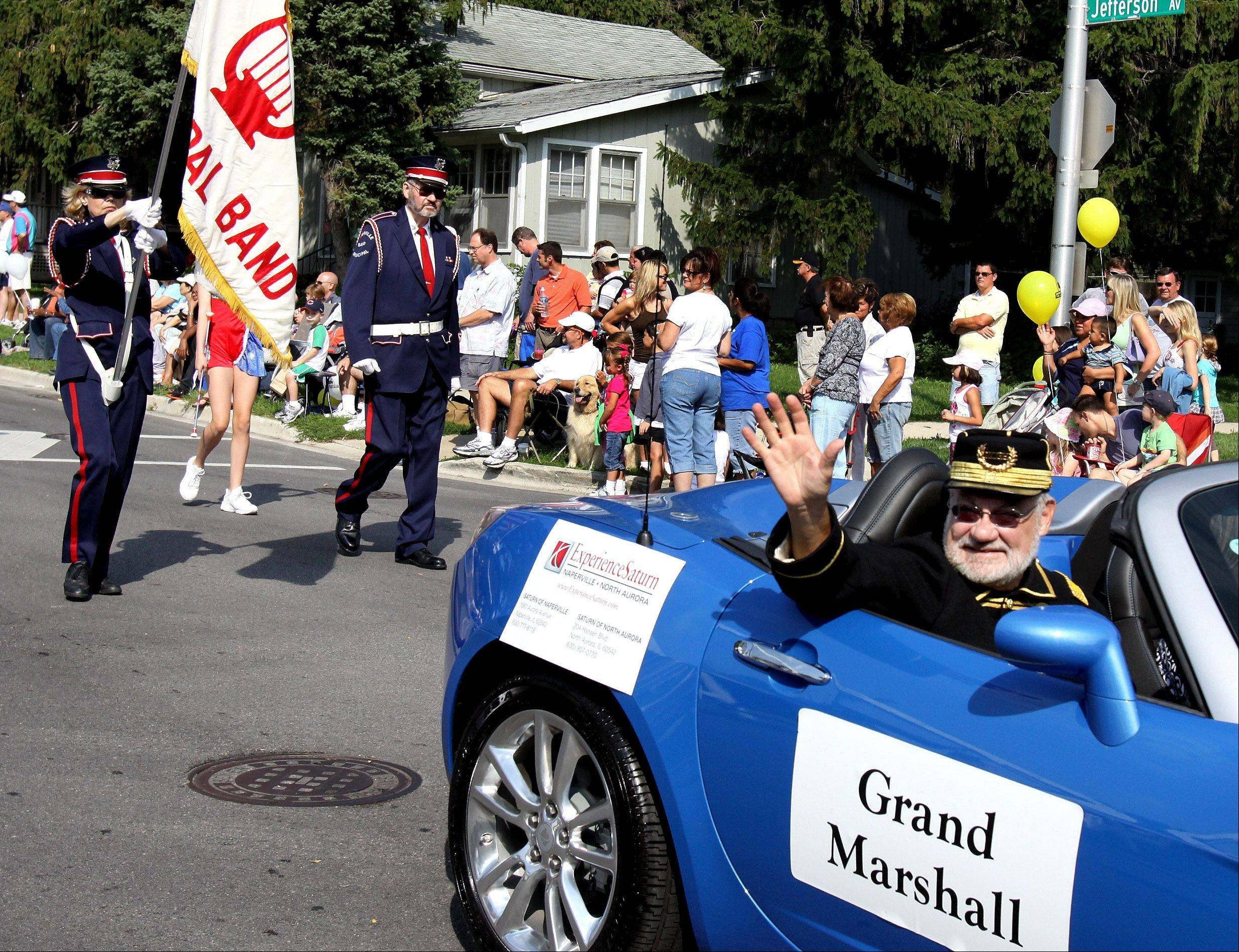 Ron Keller, director of the Naperville Municipal Band, serves as grand marshal in a past Labor Day Parade. This year�s parade, at 10 a.m. Monday, Sept. 2, will honor the Naperville Area Chamber of Commerce as grand marshal during the chamber�s 100th anniversary year.