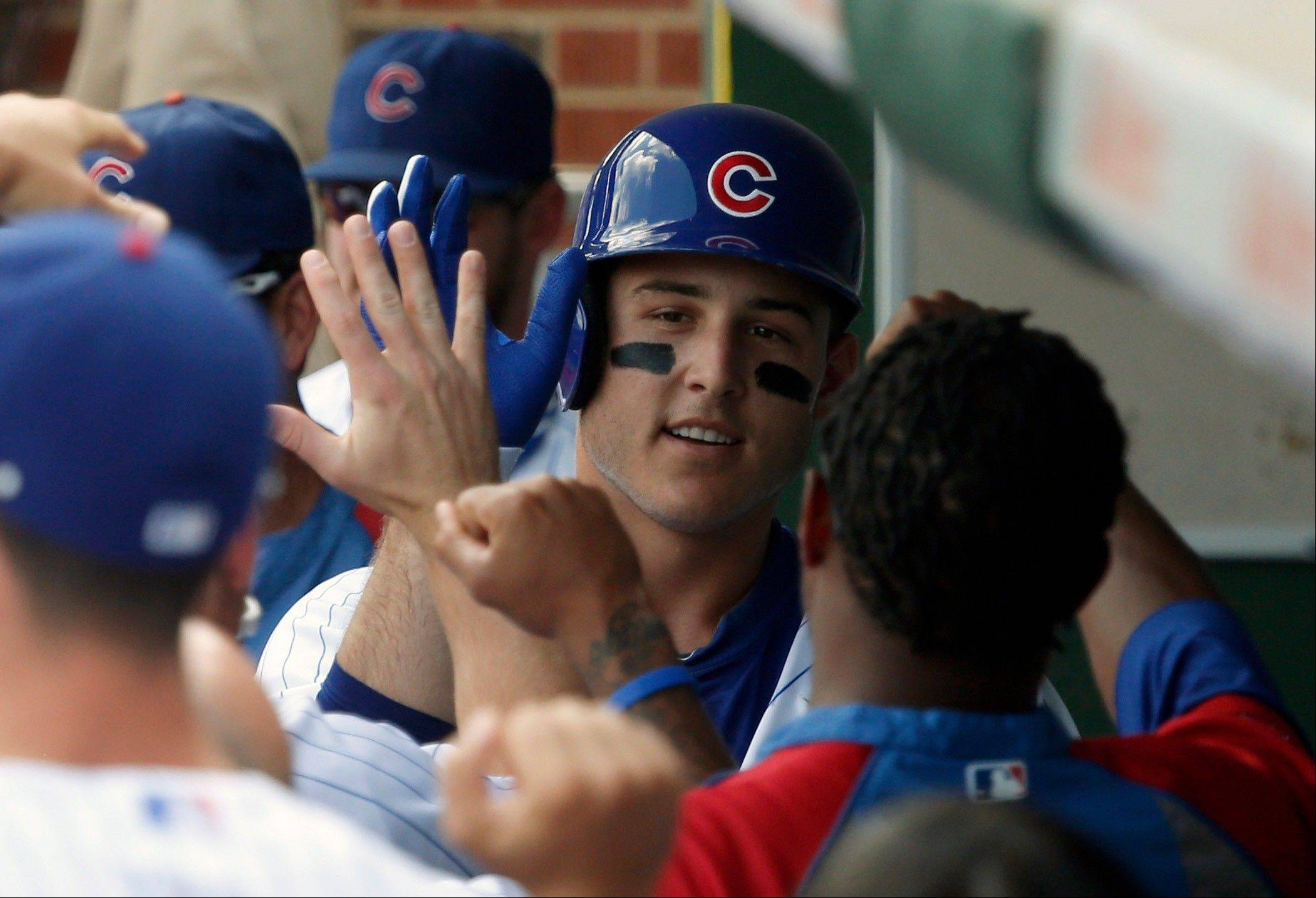 The Cubs' Anthony Rizzo celebrates his home run in the first inning Friday against the Phillies at Wrigley Field.