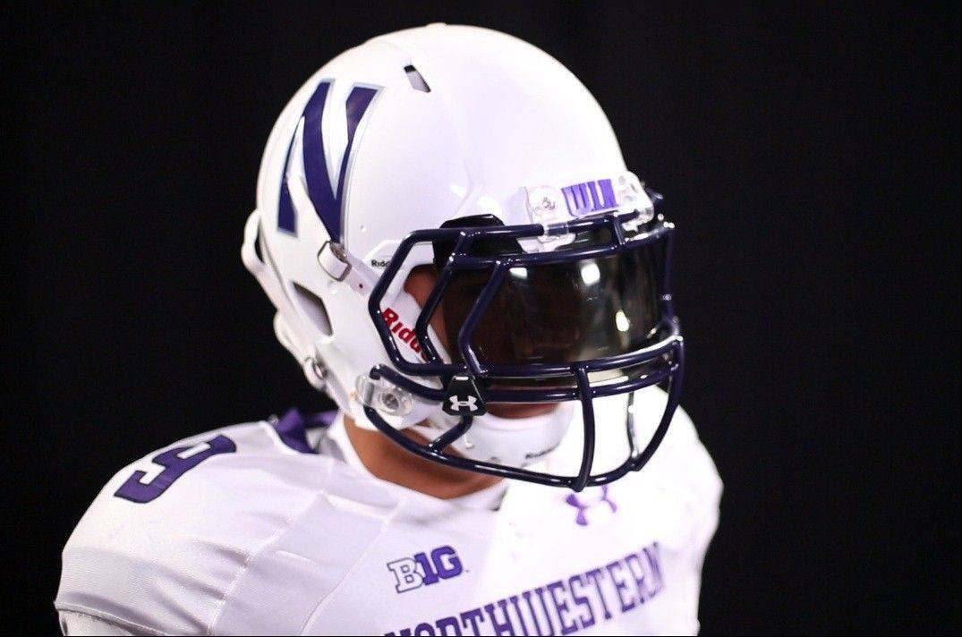 Northwestern�s football team will wear new white helmets for Saturday night�s opener at California in a nationally televised game on ESPN2.