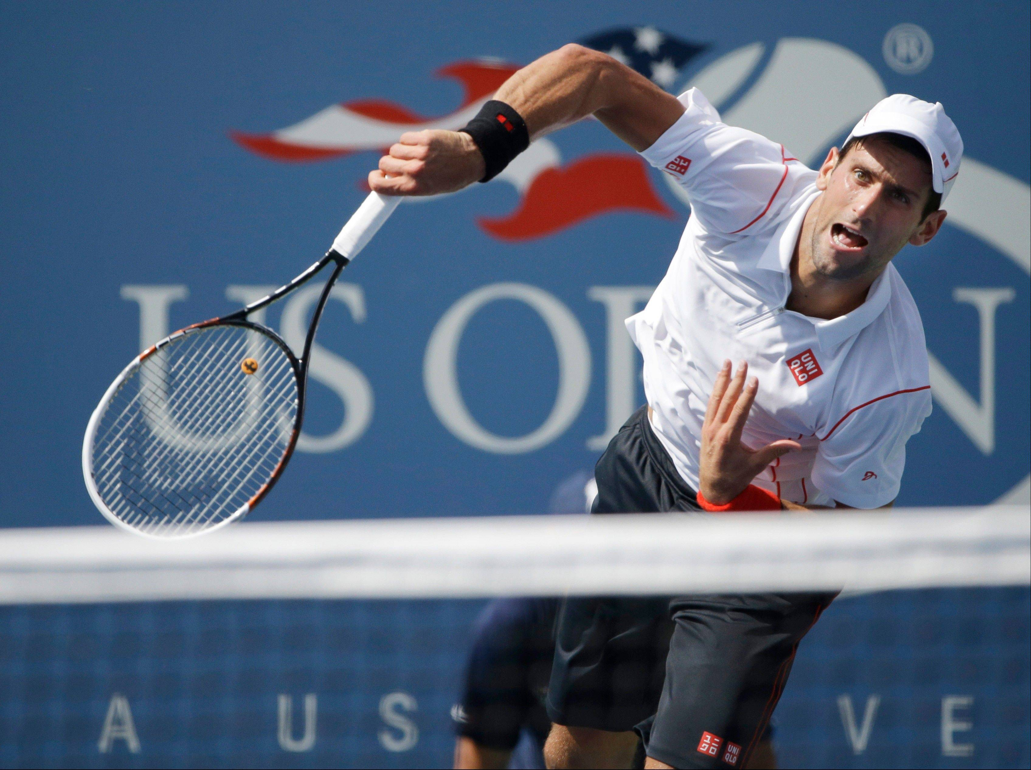 Novak Djokovic serves against Benjamin Becker during the second round of the U.S. Open on Friday in New York.