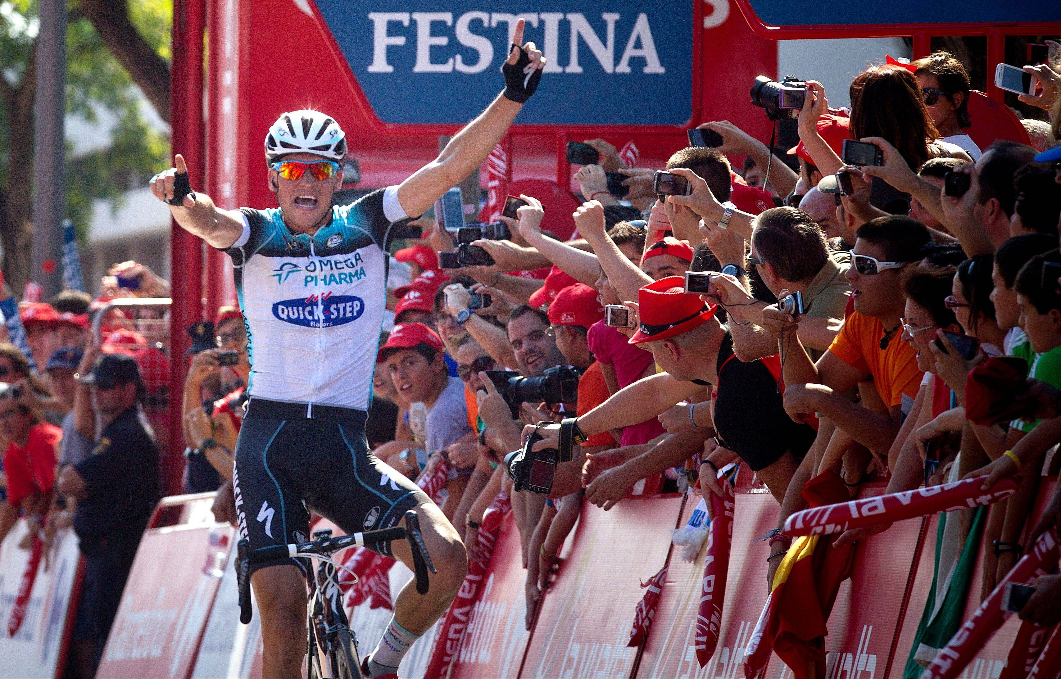 Czech Zdenek Stybar of team Omega Pharma-QuickStep celebrates as he crosses the finish line to win the seventh stage of the Spanish Vuelta on Friday in Mairena del Aljarafe.