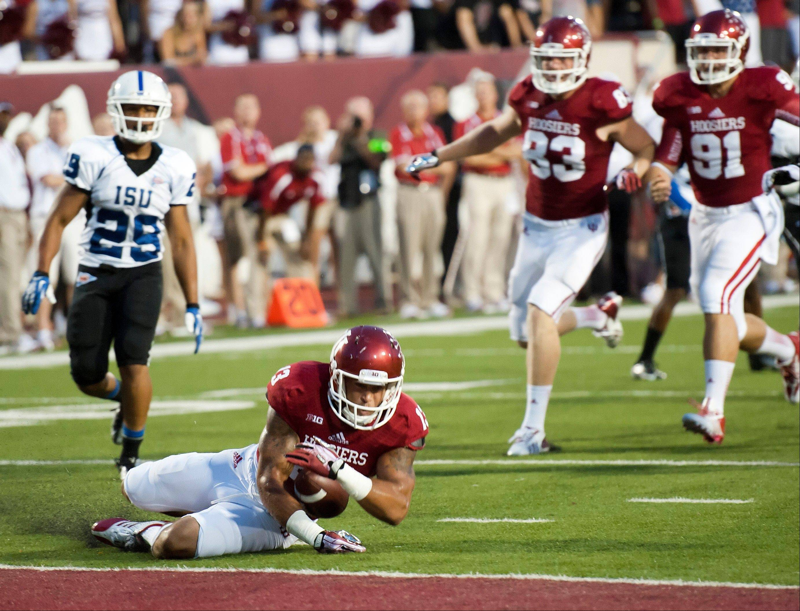 Indiana�s Kofi Hughes downs a punt at the goal line during Thursday�s game against Indiana State in Bloomington, Ind.