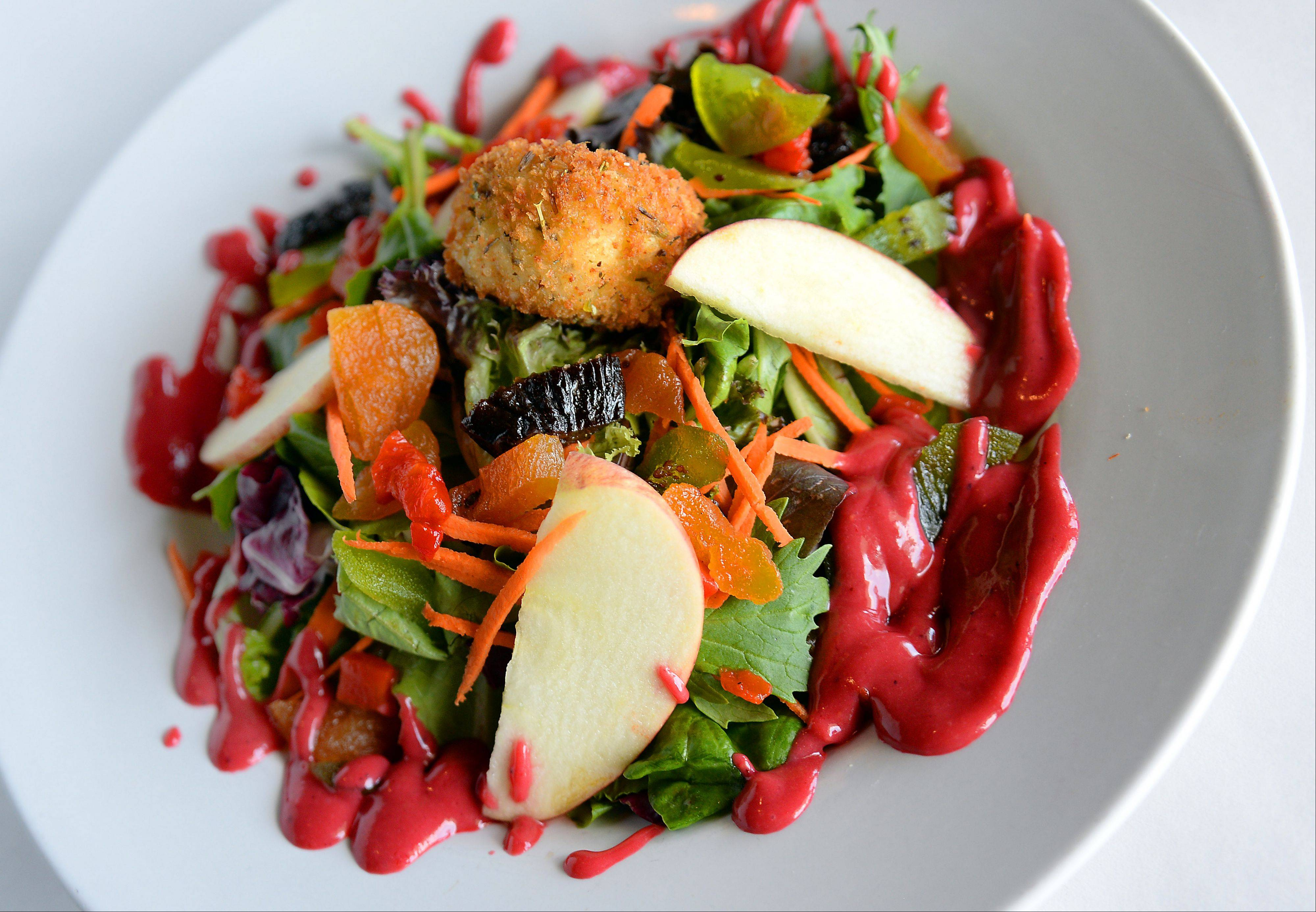 Chef Chris Barth's menu contains classic French fare, like this goat cheese salad.