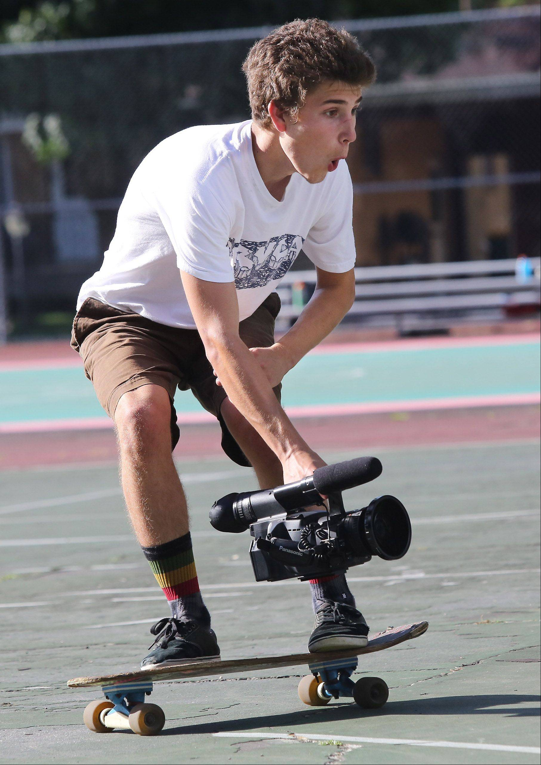 It helps that Kollman knows how to skate himself as he glides along next to another skateboarder for a good shot.