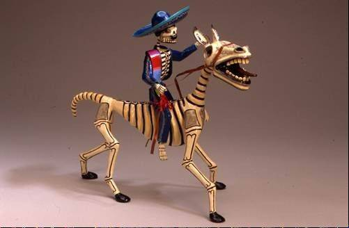 "Papier-m�ch� skeletal horse and rider by Joel Garc�a. The exhibit ""El Caballo: The Horse in Mexican Folk Art"" will run through Oct. 4 at the Waukegan Public Library."