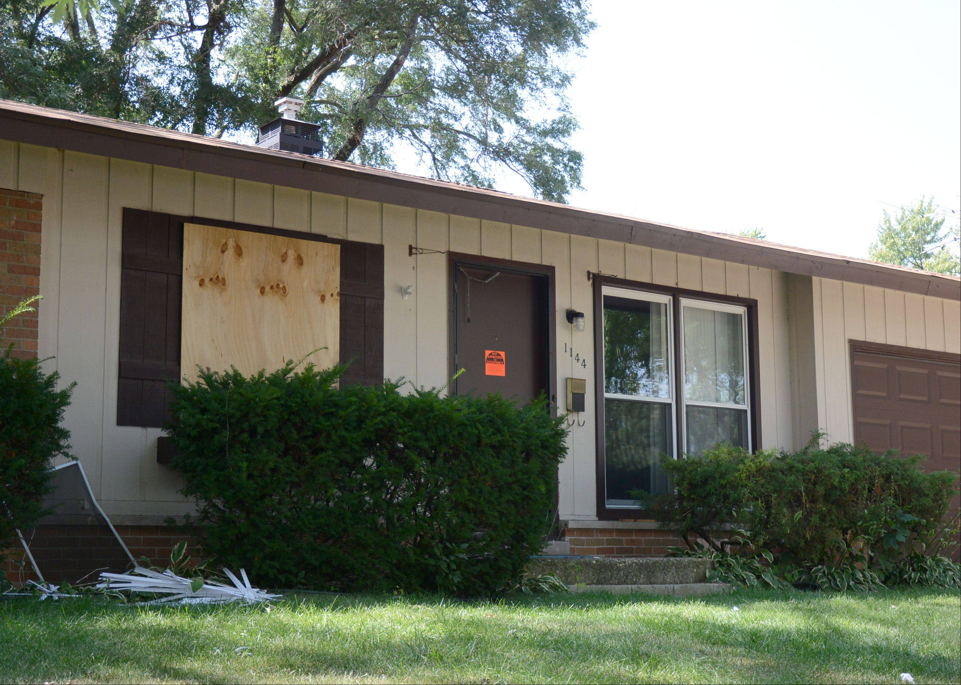 The windows of this home on Warwick Lane were boarded up Friday after the Elk Grove Village Police Department executed a search warrant there Thursday.