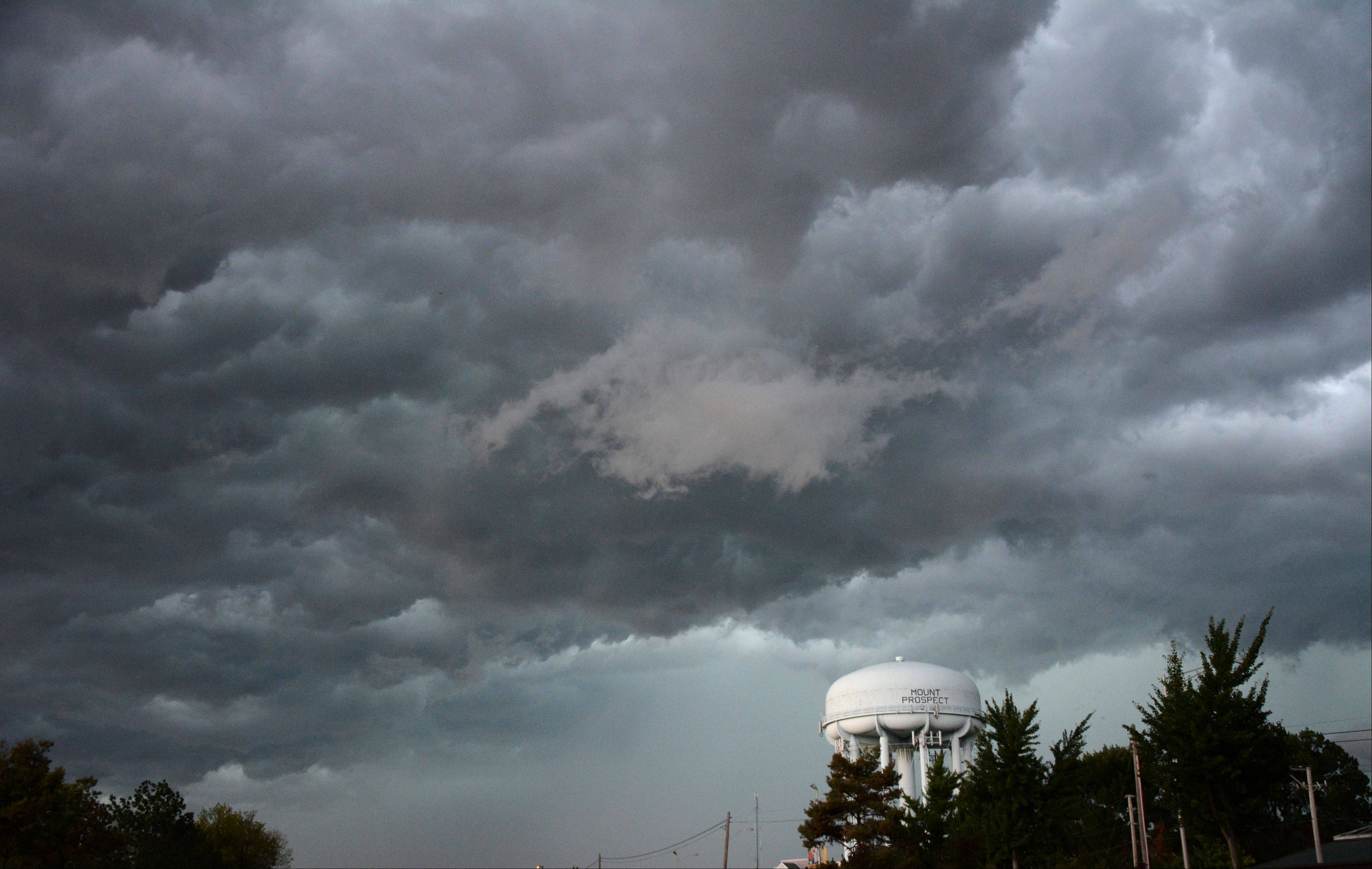 An intense storm rolls in Friday night over a water tower in Rolling Meadows.
