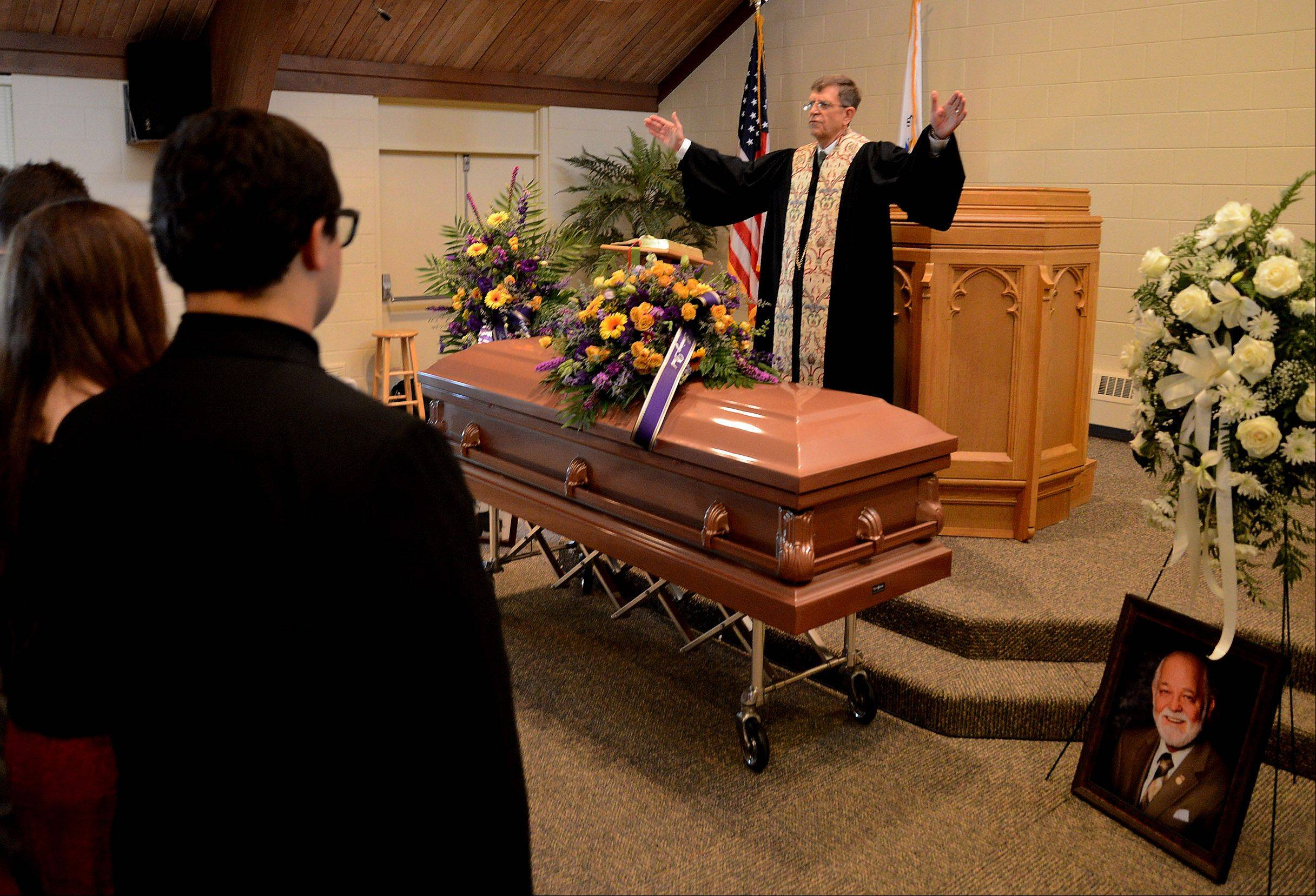 Pastor Bob Crall of the Kirk of the Lakes Presbyterian Church in Mundelein delivers the benediction at the end of the funeral of longtime Mundelein resident and volunteer John Lynn. Lynn is best known as the founder of the Kirk Players theater group.