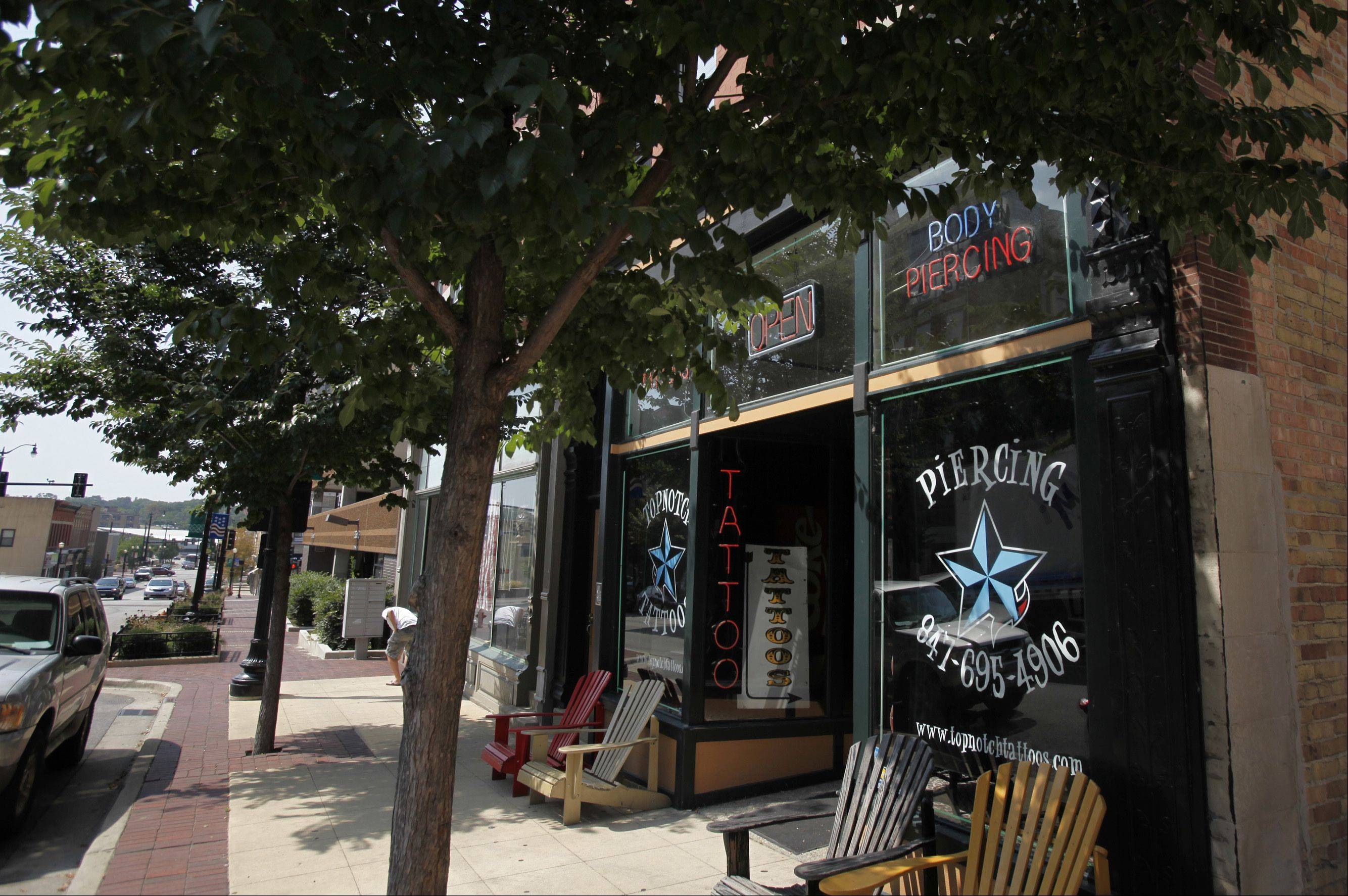 Topnotch Tattoos opened in 1999 in downtown Elgin. Two other tattoo shops are hoping to join the market after their preliminary petitions were granted Wednesday by the Elgin City Council.