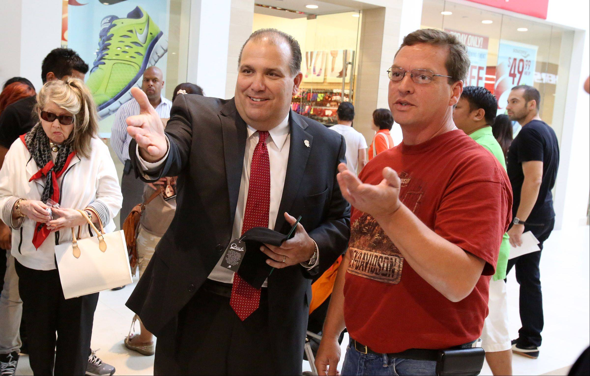 Rosemont Mayor Bradley Stephens, center, greets shoppers at the Fashion Outlets of Chicago during its opening earlier this month.