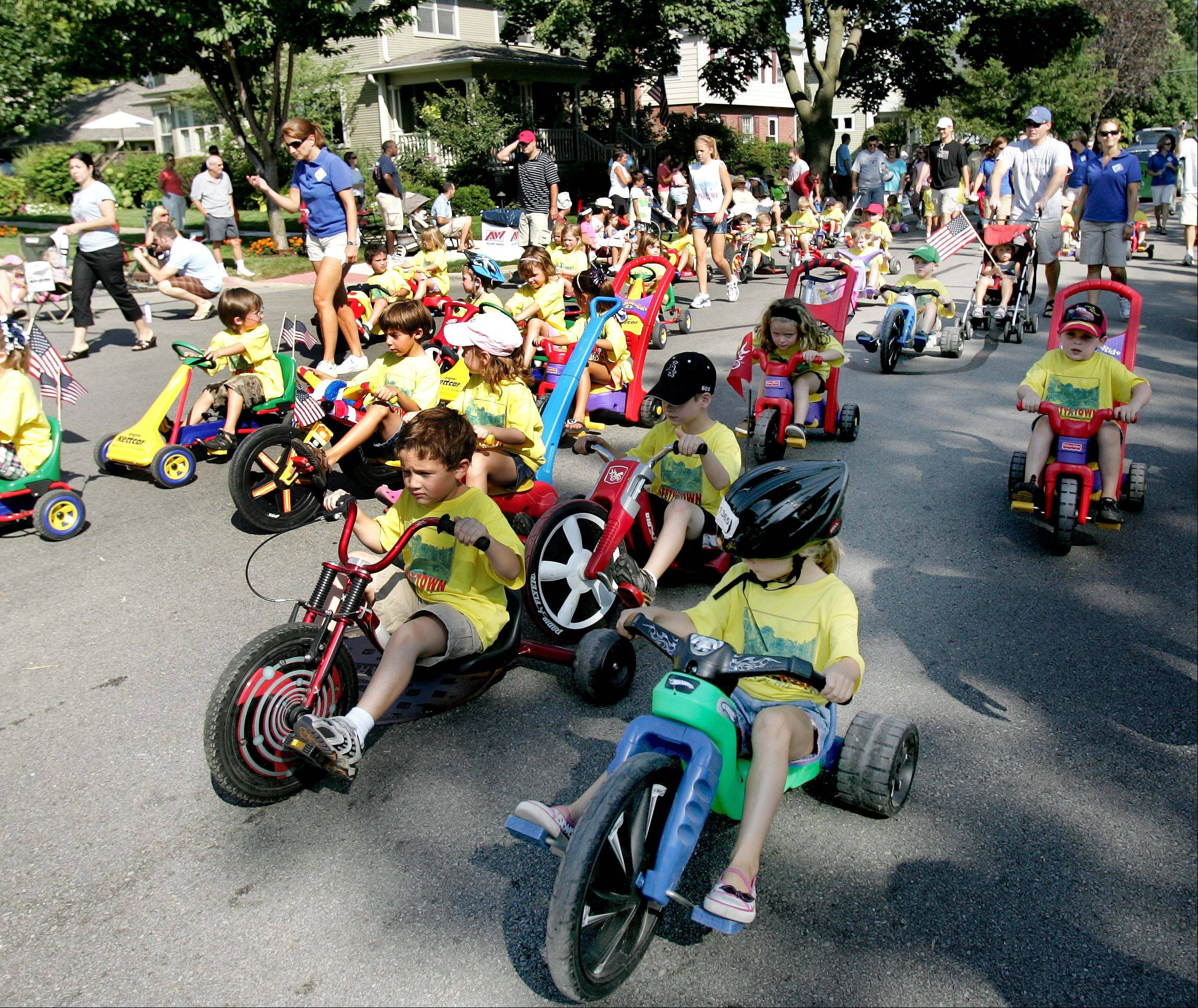 Kids on big wheels representing the Safety Town in Naperville are a frequent unit in the Labor Day Parade during the Last Fling. This year's parade steps off at 10 a.m. Monday, Sept. 2, on Mill Street at Naperville North High School.