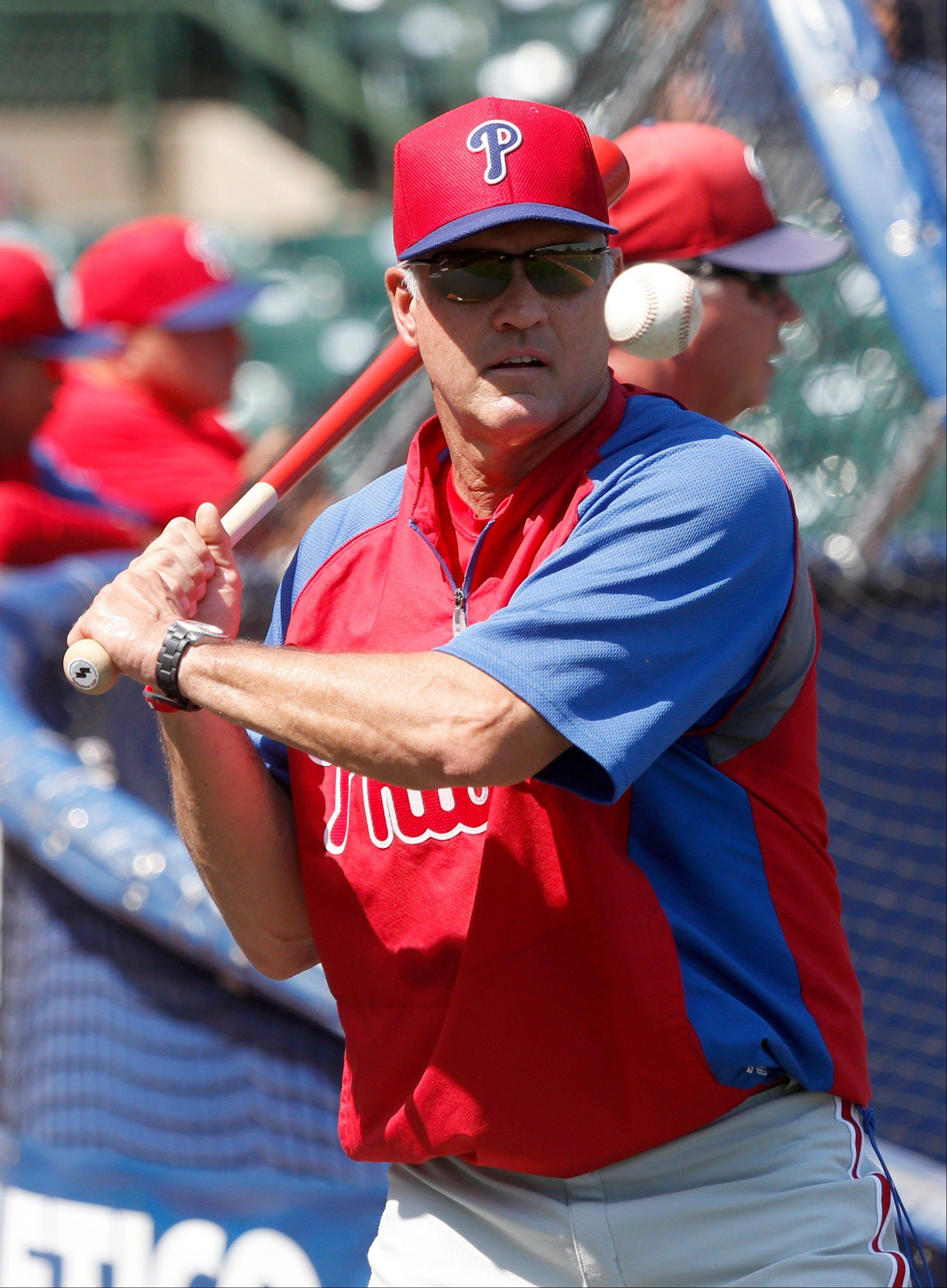 Phillies interim manager Ryne Sandberg conducts infield practice Friday at Wrigley Field.