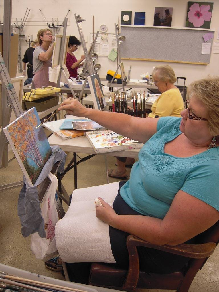 "Cynthia Meyer puts the finishing touches on her oil painting ""Golden River Birch"" during her art class with Marge Hall at the DuPage Art League in Wheaton, Illinois.  The linen canvas has a lot of ""tooth"", or texture, which took more paint to cover and added to the ""misty"" feeling of the image."