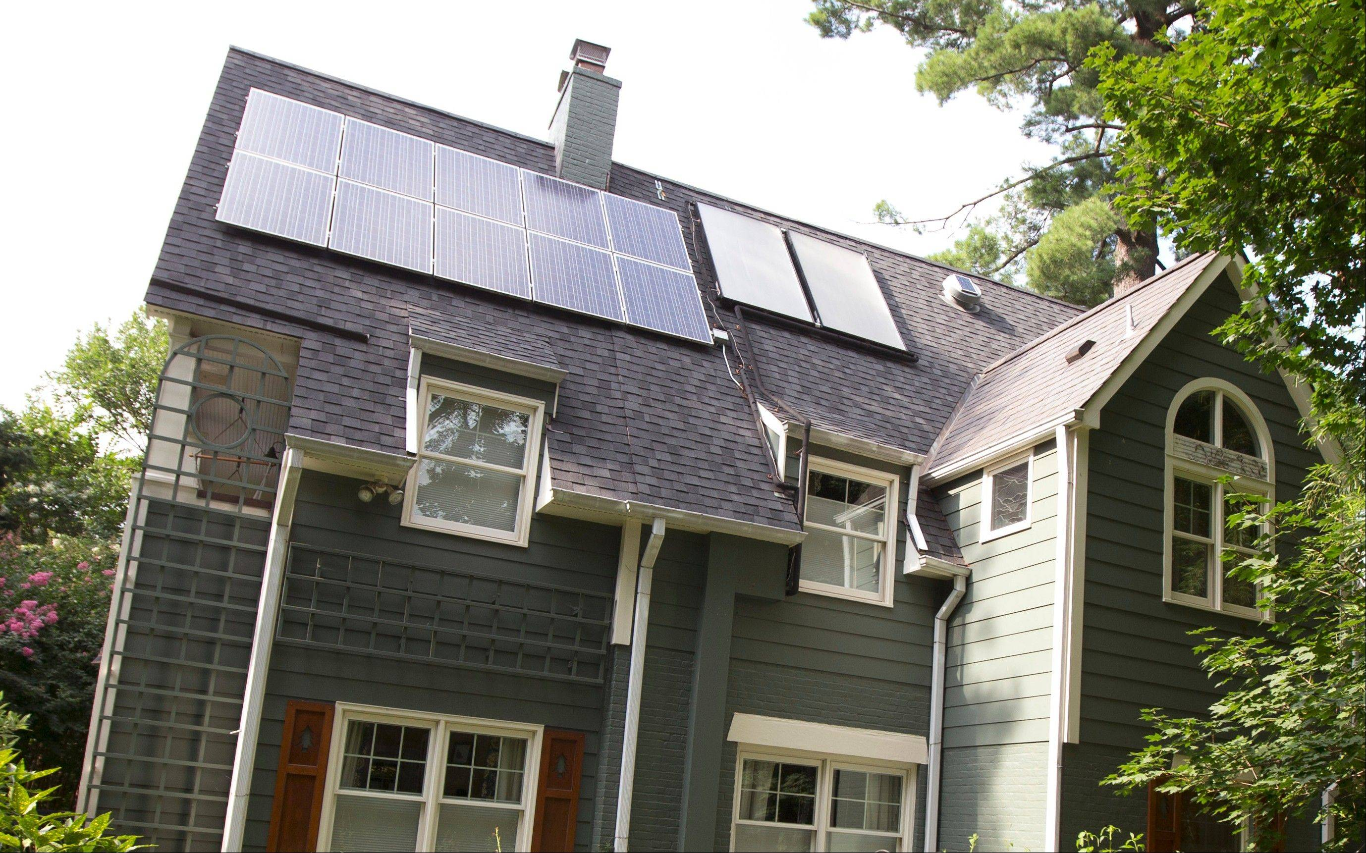 To help neighbors, Ketch Ryan, owner of this house in Chevy Chase, Md., helped establish a solar cooperative, Common Cents Solar.