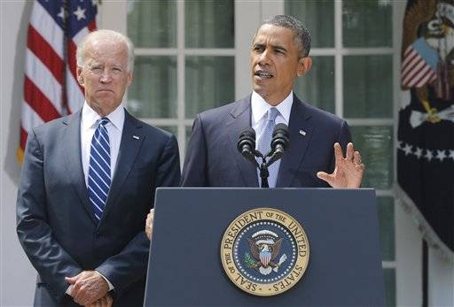 President Barack Obama stands with Vice President Joe Biden as he makes a statement about Syria in the Rose Garden at the White House in Washington, Saturday, Aug. 31, 2013. Obama said he has decided that the United States should take military action against Syria in response to a deadly chemical weapons attack, and said he will seek congressional authorization for the use of force.