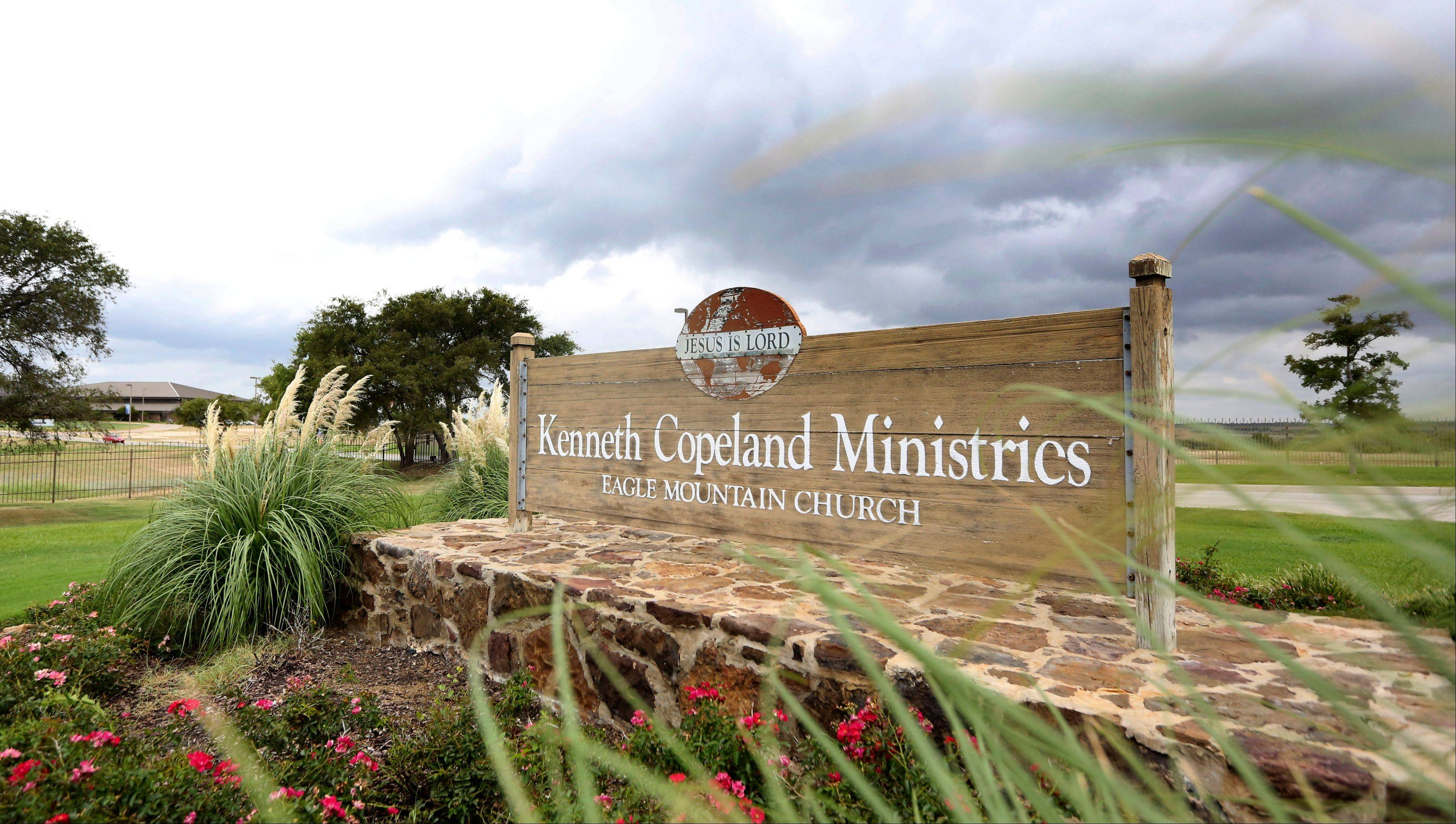 A sign sits Tuesday at the entrance of the Kenneth Copeland Ministries Eagle Mountain Church, in Newark, Texas. The Texas megachurch is linked to at least 21 cases of measles and has been trying to contain the outbreak by hosting vaccination clinics, officials said.