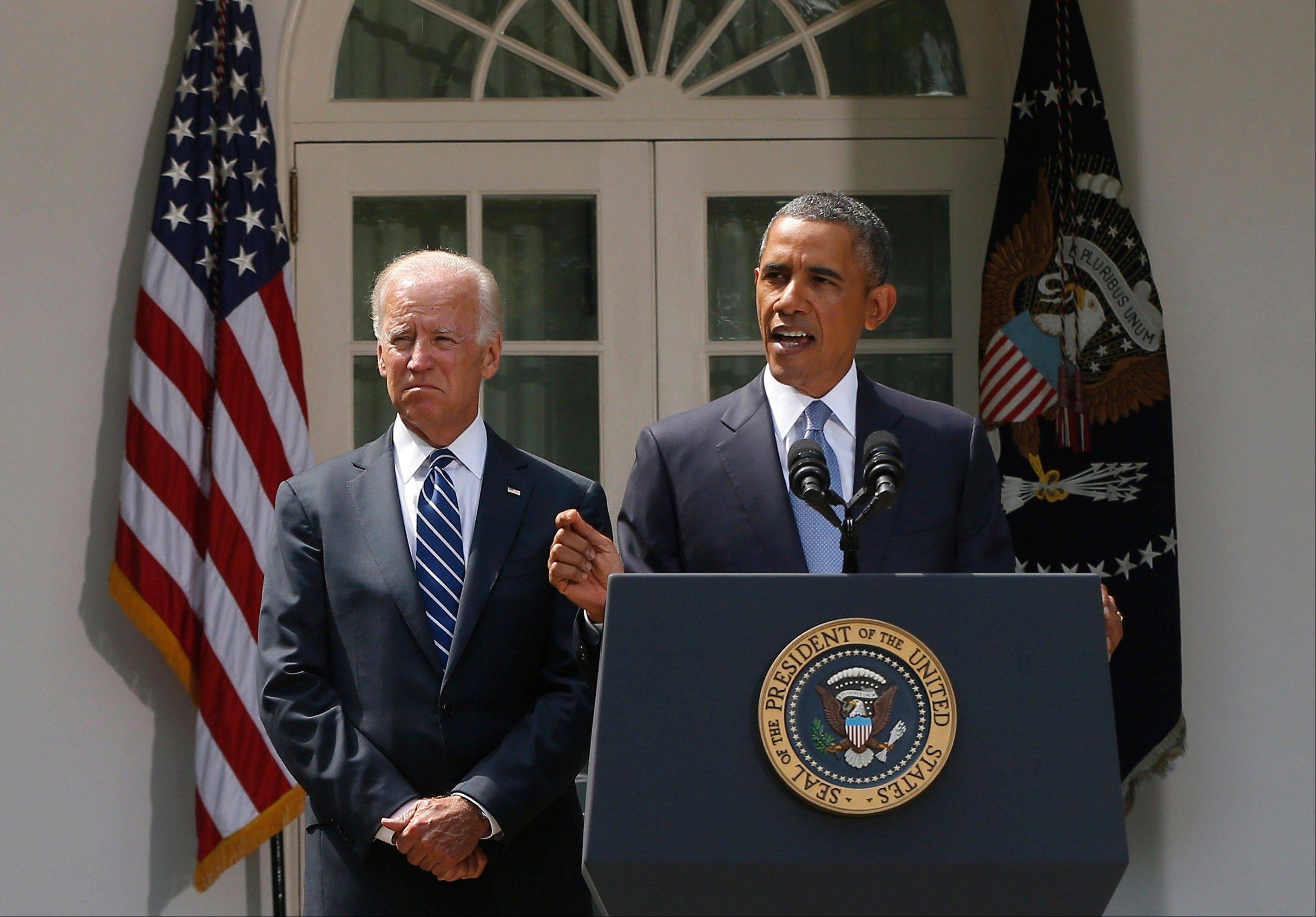 President Barack Obama stands with Vice President Joe Biden Saturday as he makes a statement about the crisis in Syria in the Rose Garden at the White House in Washington.