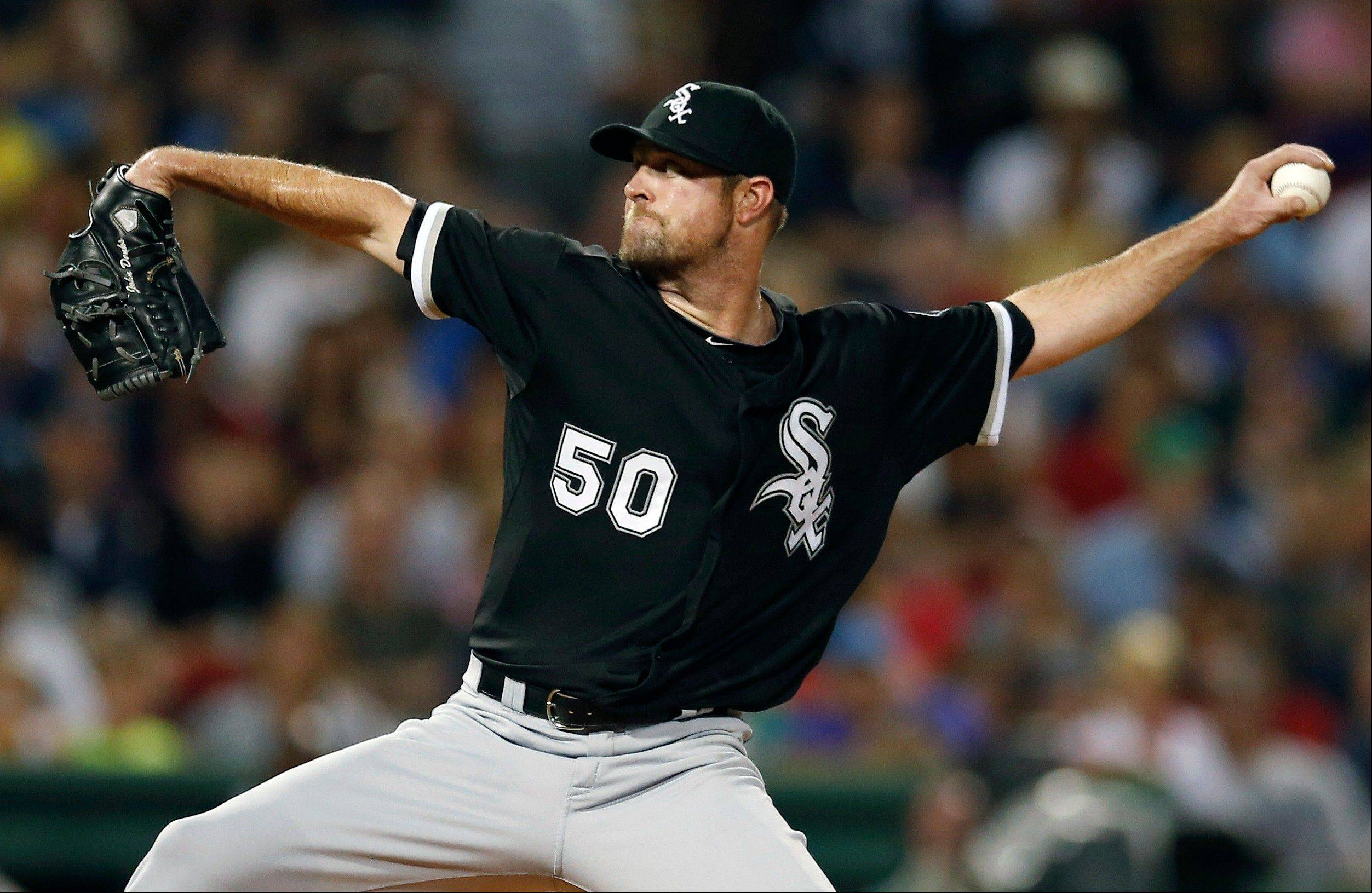 Chicago White Sox's John Danks pitches in the first inning against the Boston Red Sox in Boston, Saturday.