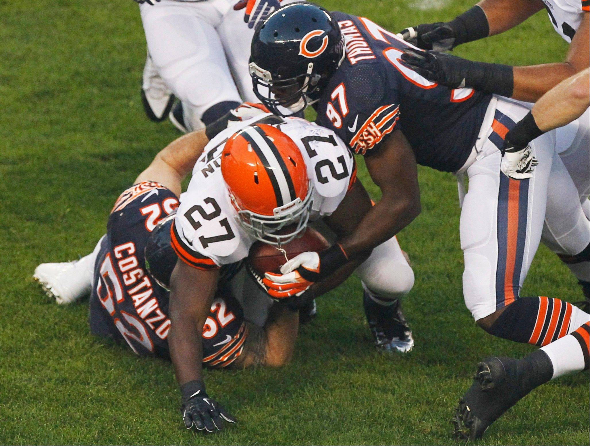 Bears linebackers Blake Costanzo (52) and J.T. Thomas stop Browns running back Brandon Jackson during preseason action Thursday at Soldier Field.
