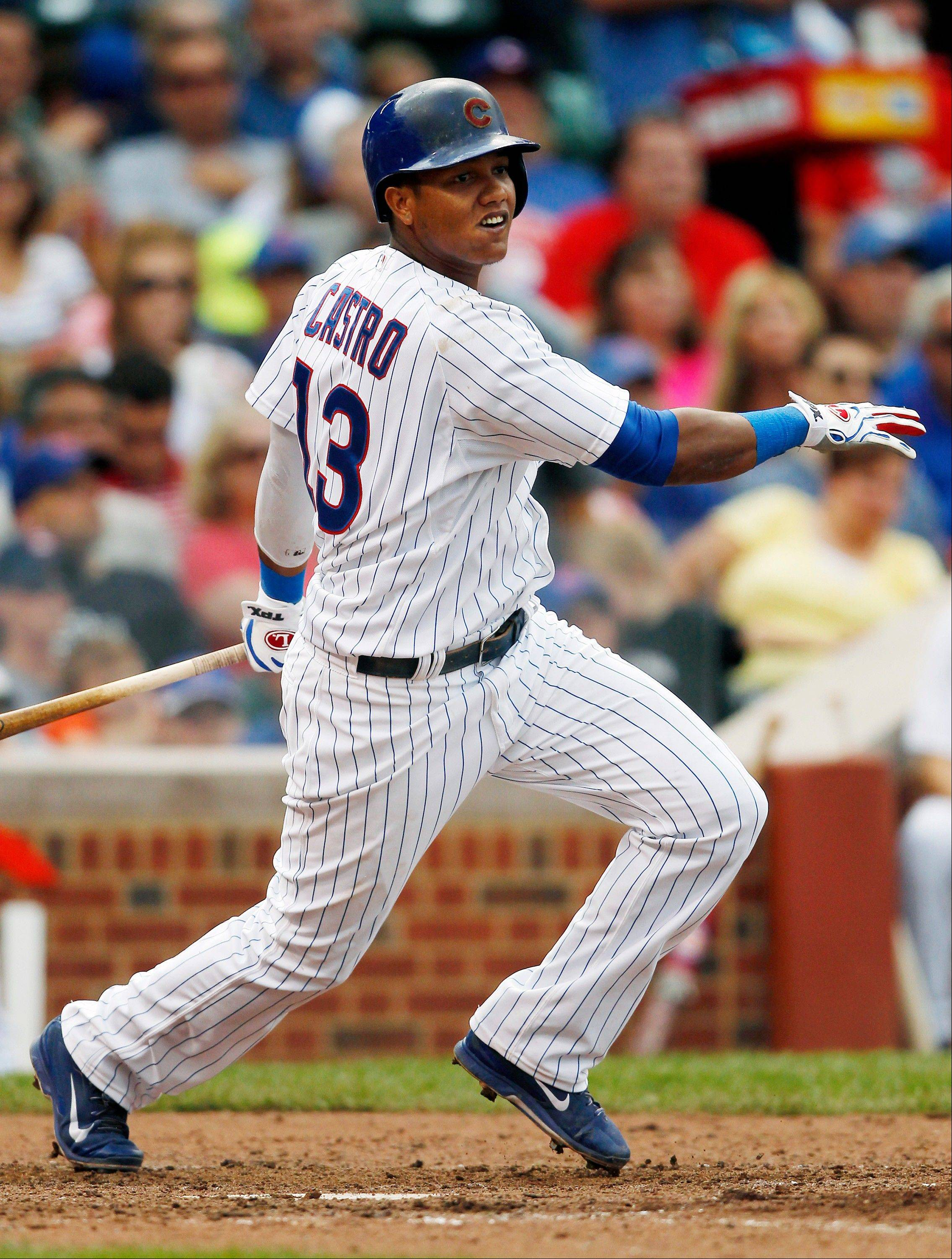 Chicago Cubs' Starlin Castro hits a double against the Philadelphia Phillies during the fourth inning of a baseball game on Saturday in Chicago.