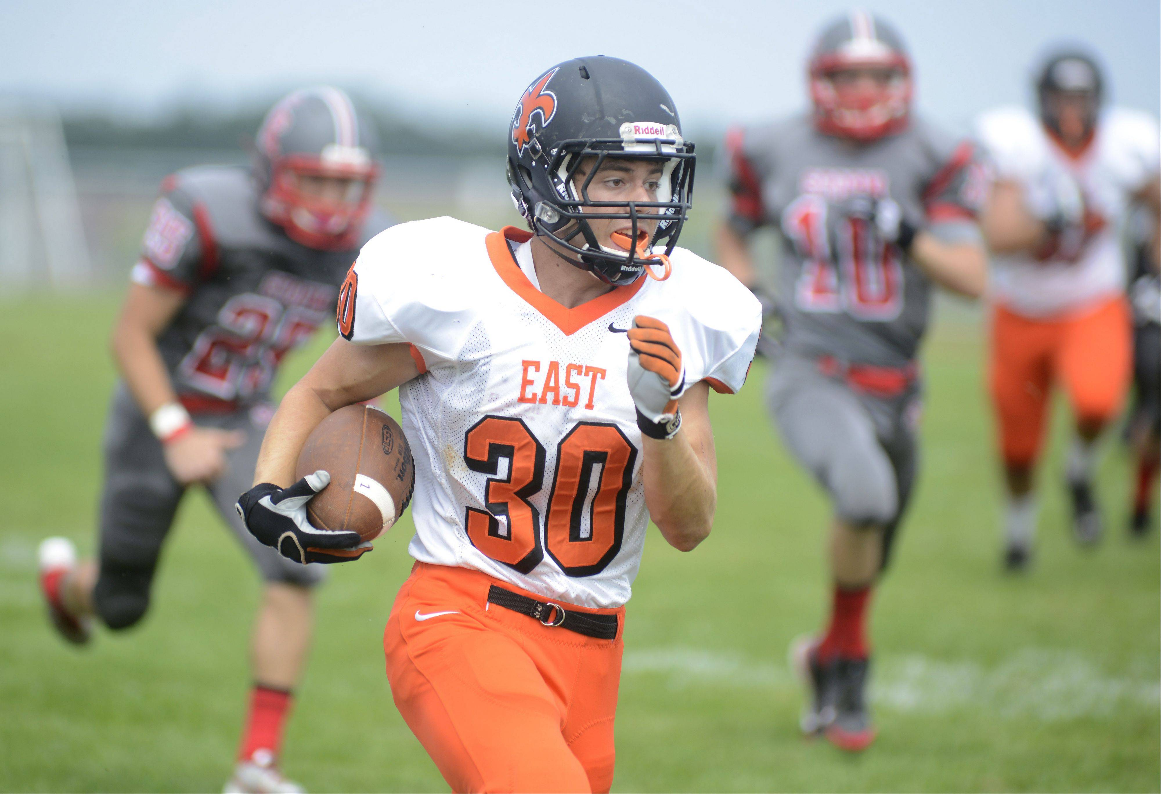 Laura Stoecker/lstoecker@dailyherald.com St. Charles East's Mitch Munroe runs down the sideline on his way to making the first touchdown of the game in the first quarter vs. South Elgin on Saturday, August 31.