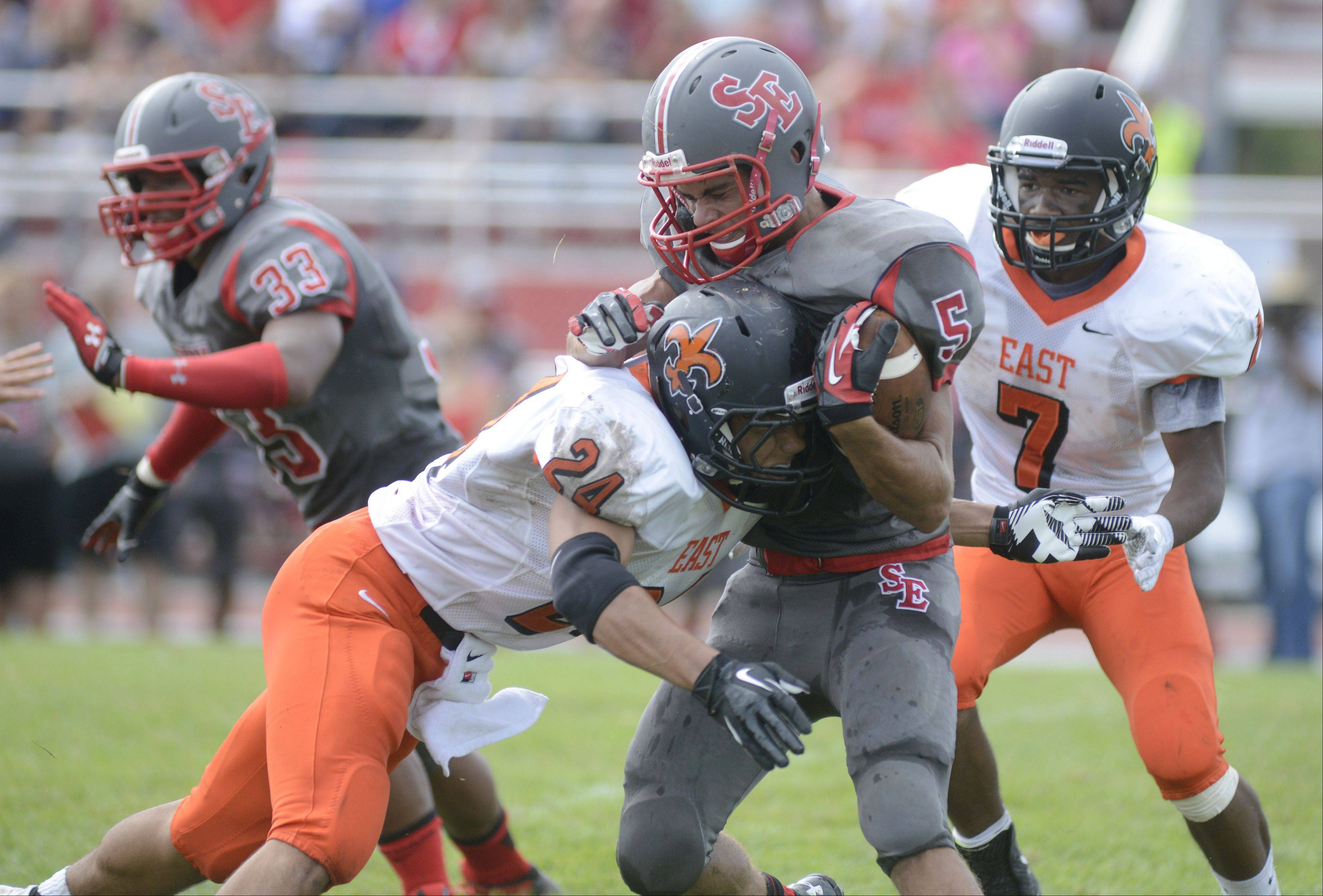 St. Charles East�s Ramon Lopez takes down South Elgin�s Tyler Christensen in the first quarter on Saturday, August 31.