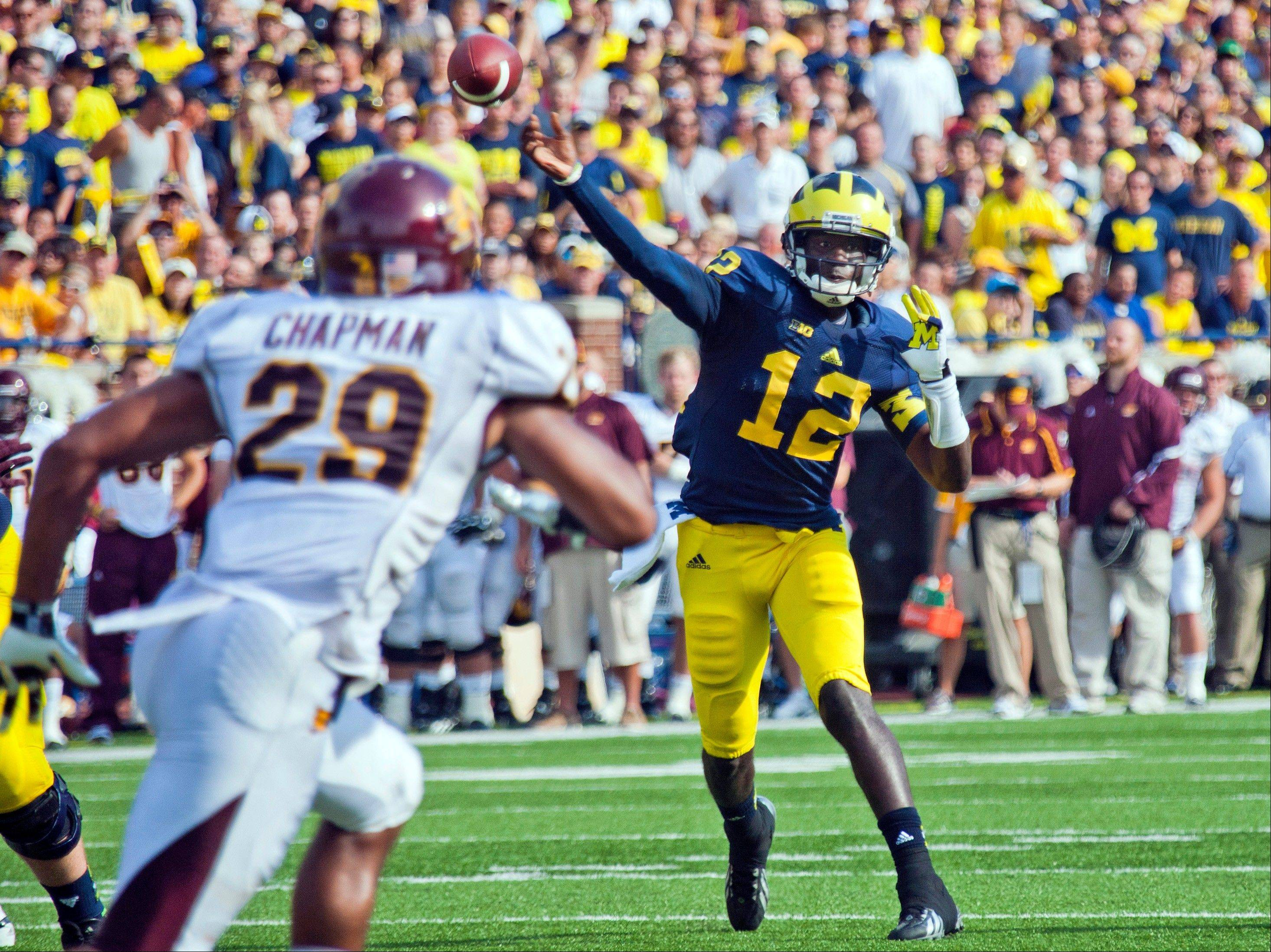 Michigan quarterback Devin Gardner (12) throws a touchdown pass into coverage in the second quarter of an NCAA college football game Saturday against Central Michigan in Ann Arbor, Mich.