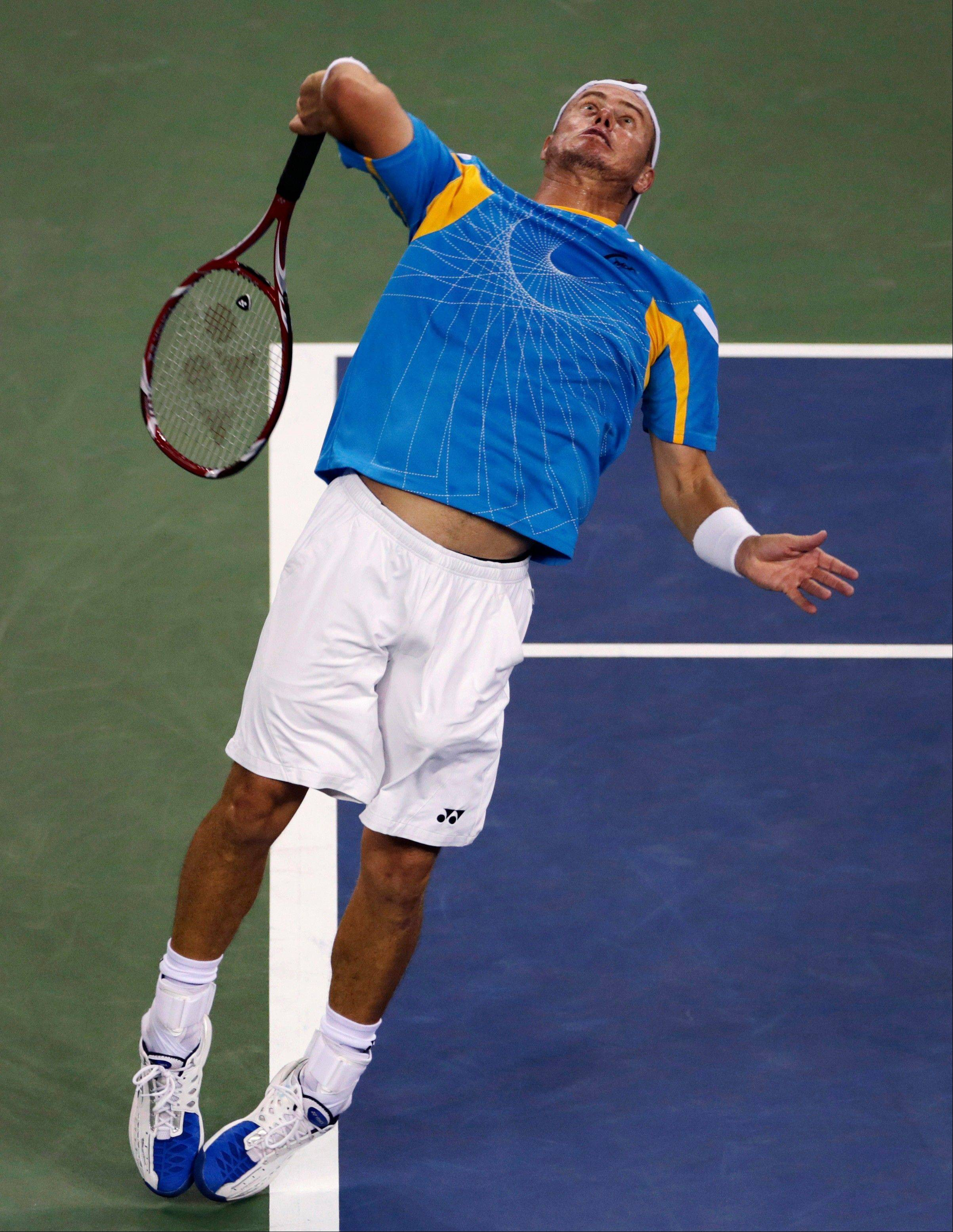 Lleyton Hewitt leaps to serve against Juan Martin del Potro during the second round of the U.S. Open Friday in New York.