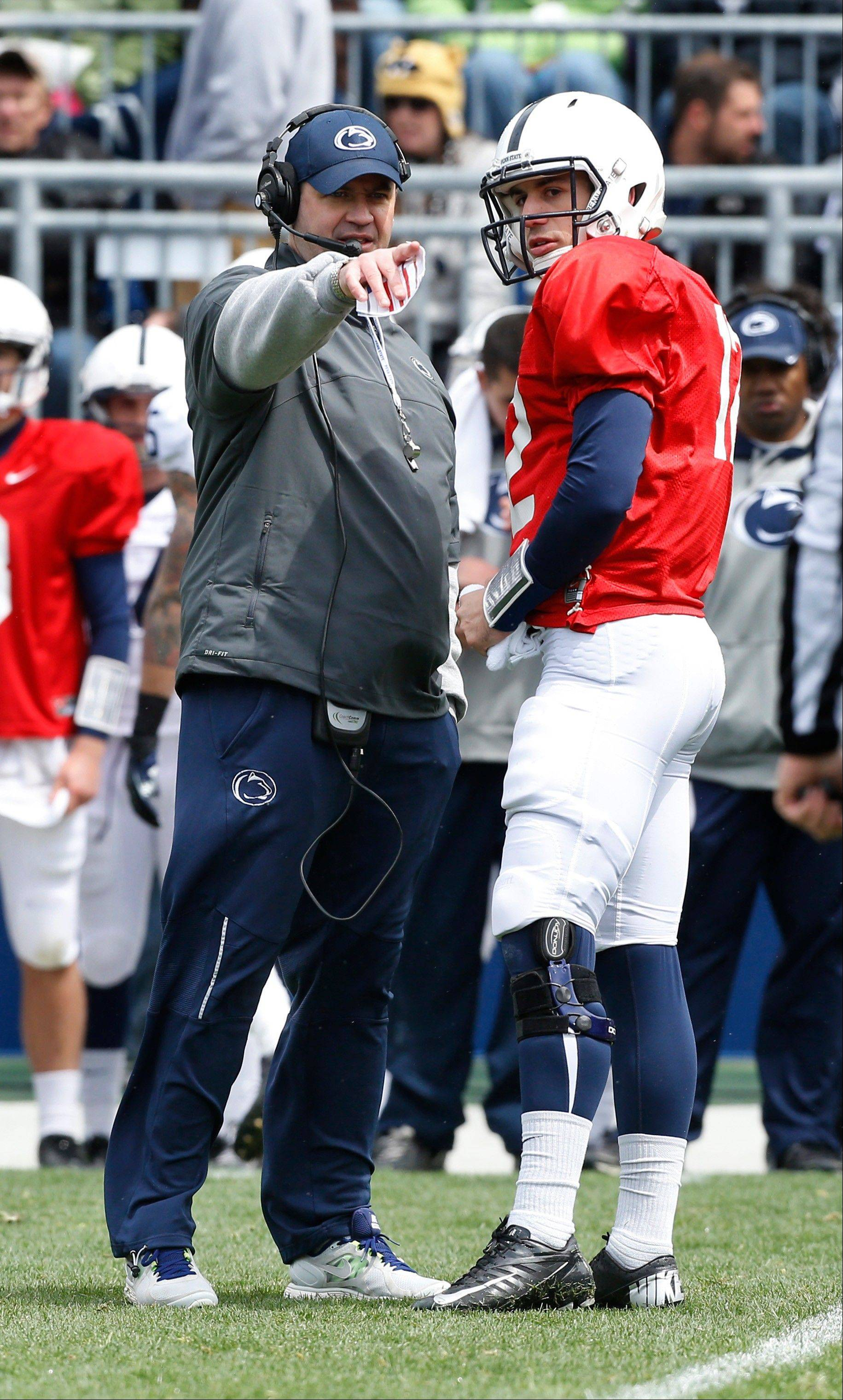 Penn State head coach Bill O�Brien talks with quarterback Steven Bench during a spring game in State College, Pa. The Nittany Lions open a season of promise Saturday against Syracuse, and the quarterback situation remains unsettled, at least in the public eye.