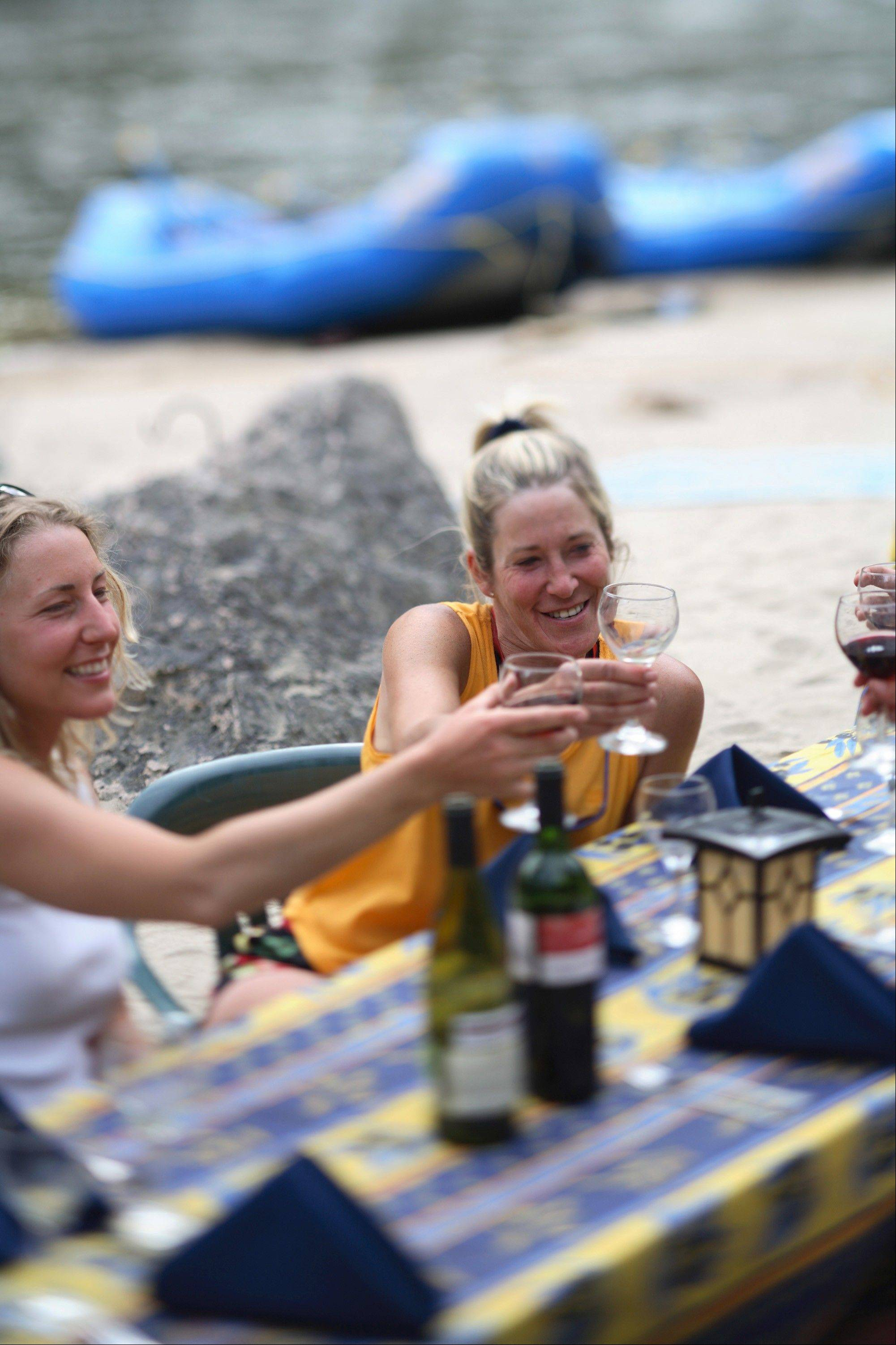 "Campers drink wine on a ""glamping"" expedition on the Middle Fork of Idaho's Salmon River, also known as the River of No Return."