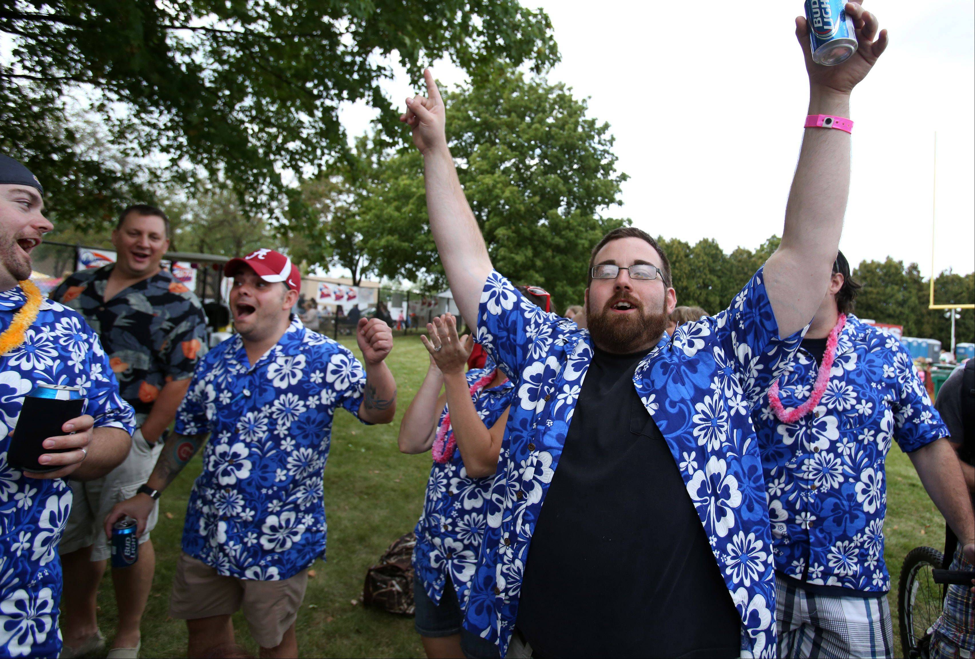 Tim Hoffman of Buffalo Grove, left center, celebrates with Steve Hoffman after Tim took first place in the hamburger category of the the BBQ cookoff Saturday during Buffalo Grove Days in Buffalo Grove. Tim also took third in the chicken category.