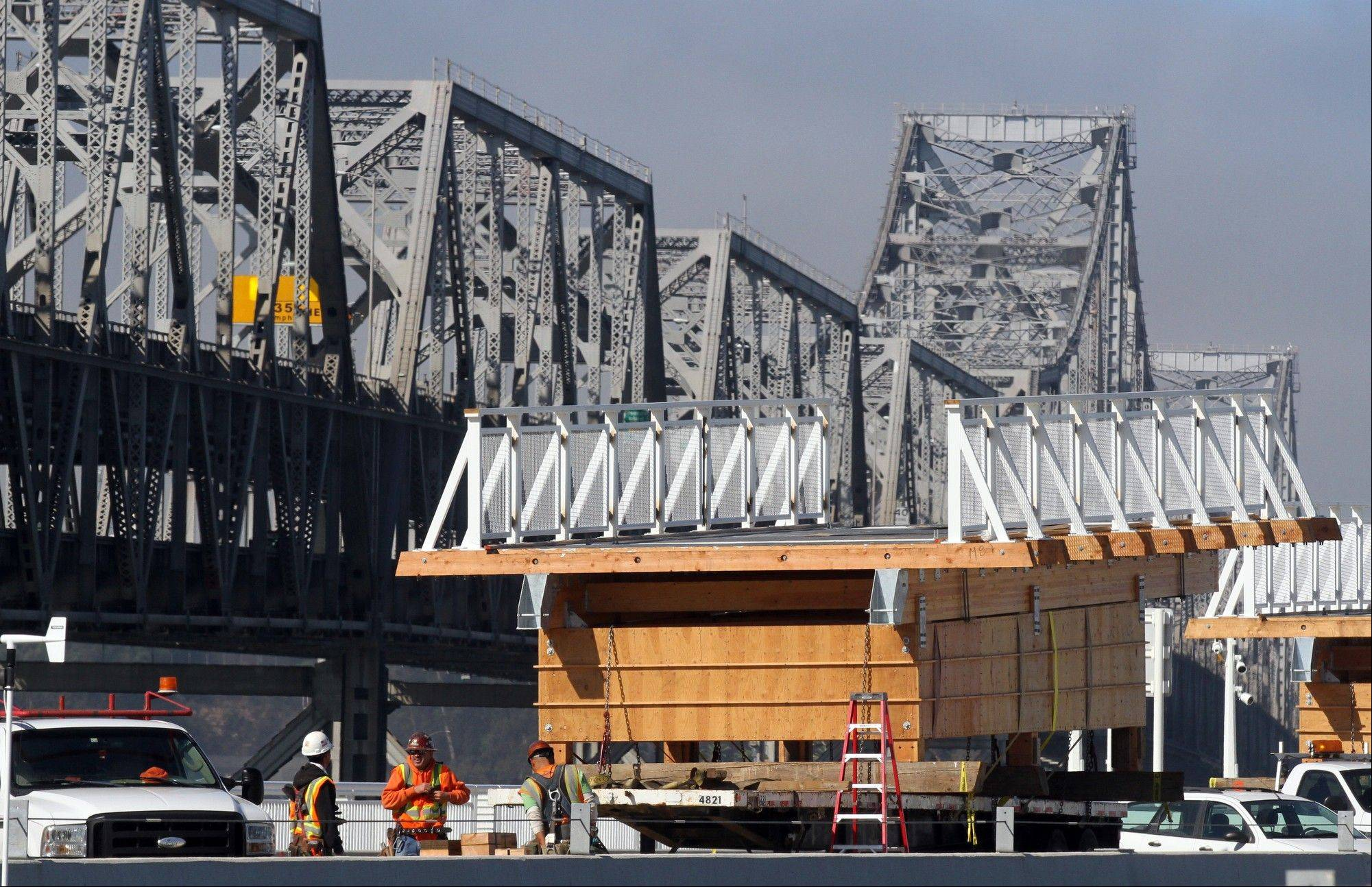 Pre-built sections of the bike bridge sit waiting to be installed Friday on the Bay Bridge in Oakland, Calif.